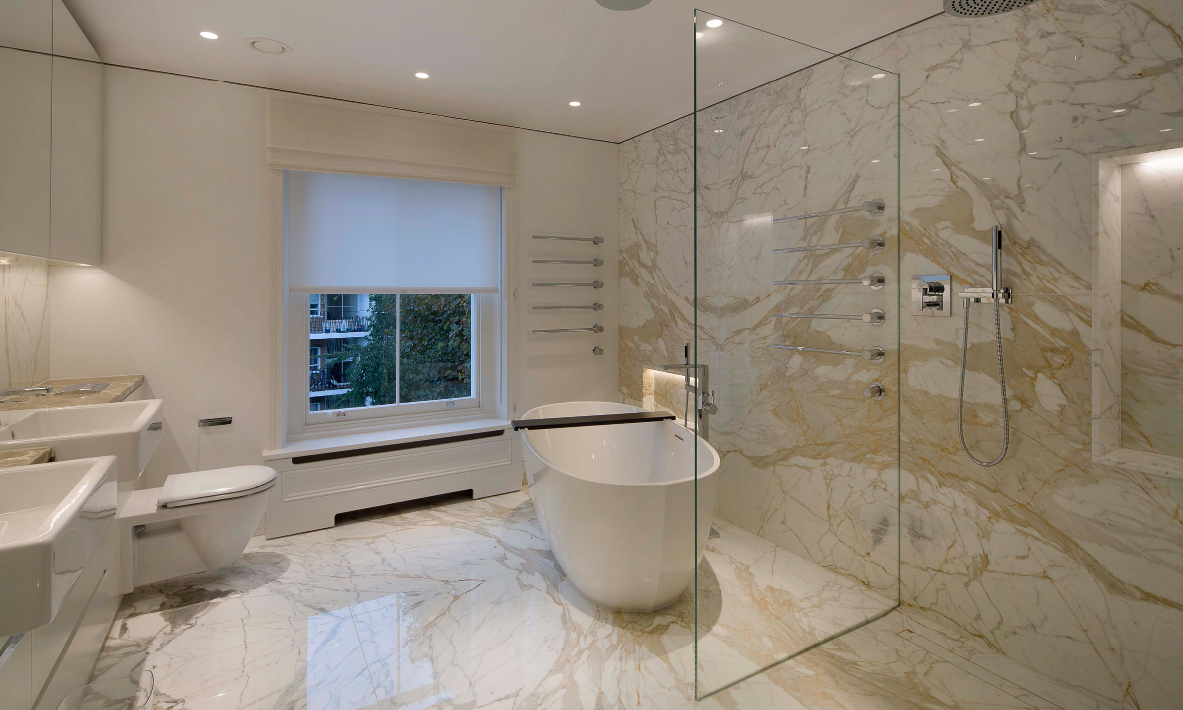 The second bathroom with feature marble wall and floor