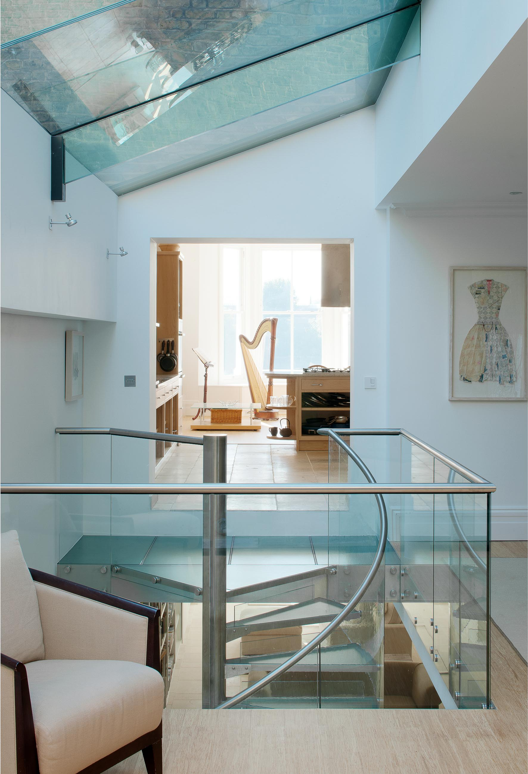 The ground floor with a featrue staircase linking the living and kitchen spaces