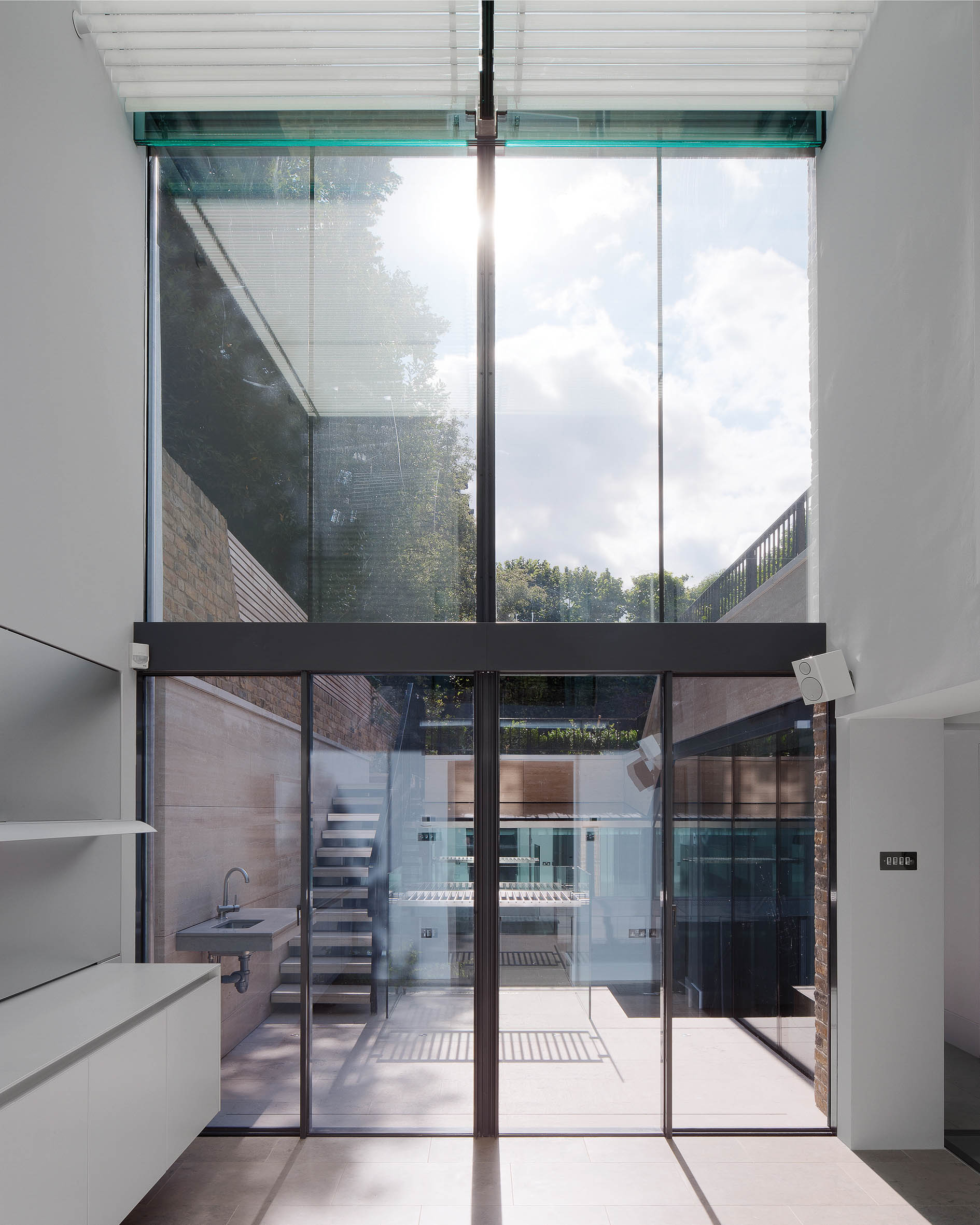 Looking through the double height kitchen and living space into the garden