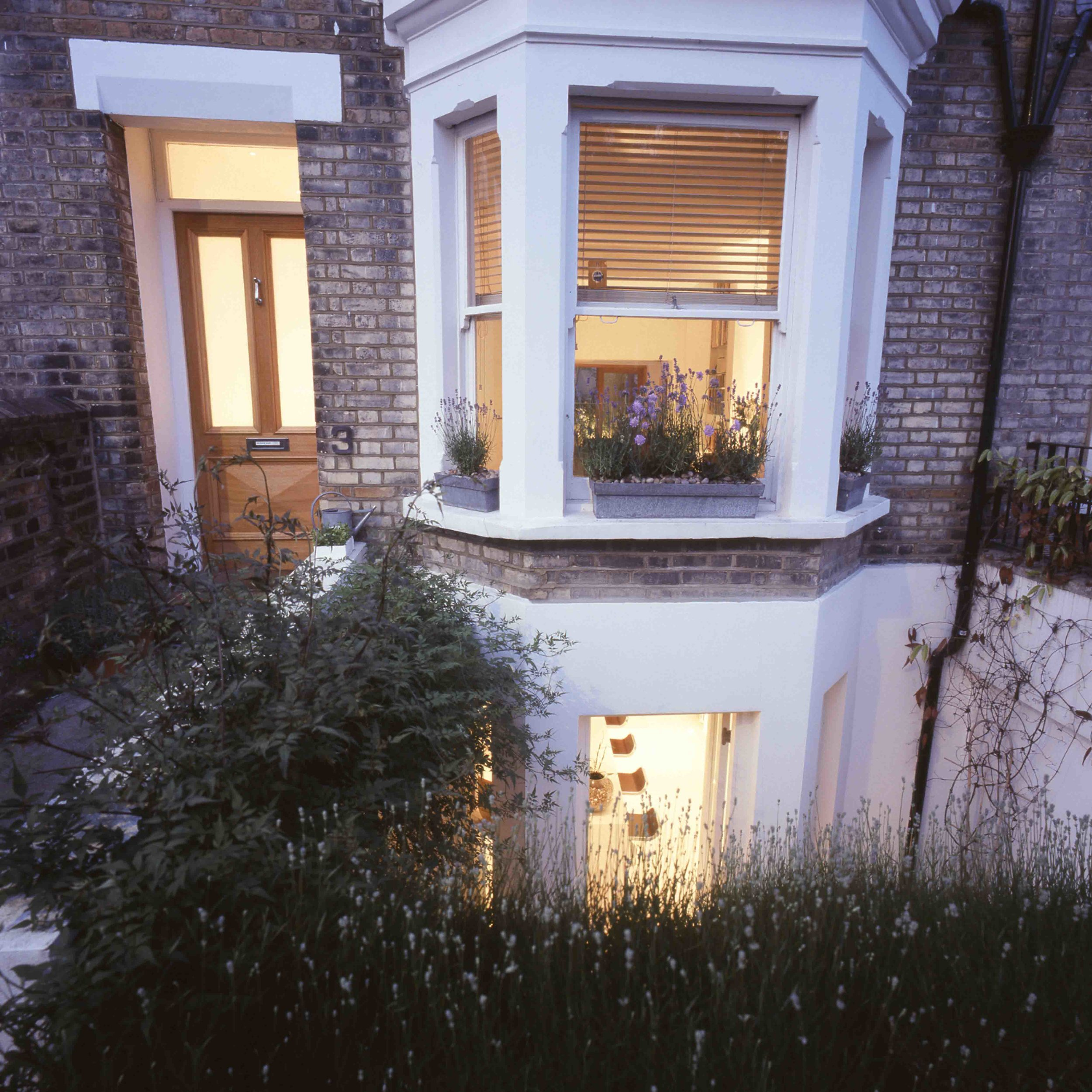 The landscaped front garden provides a green buffer to the property. It allows natural light down to the kitchen whilst also maintaining the residents privacy,