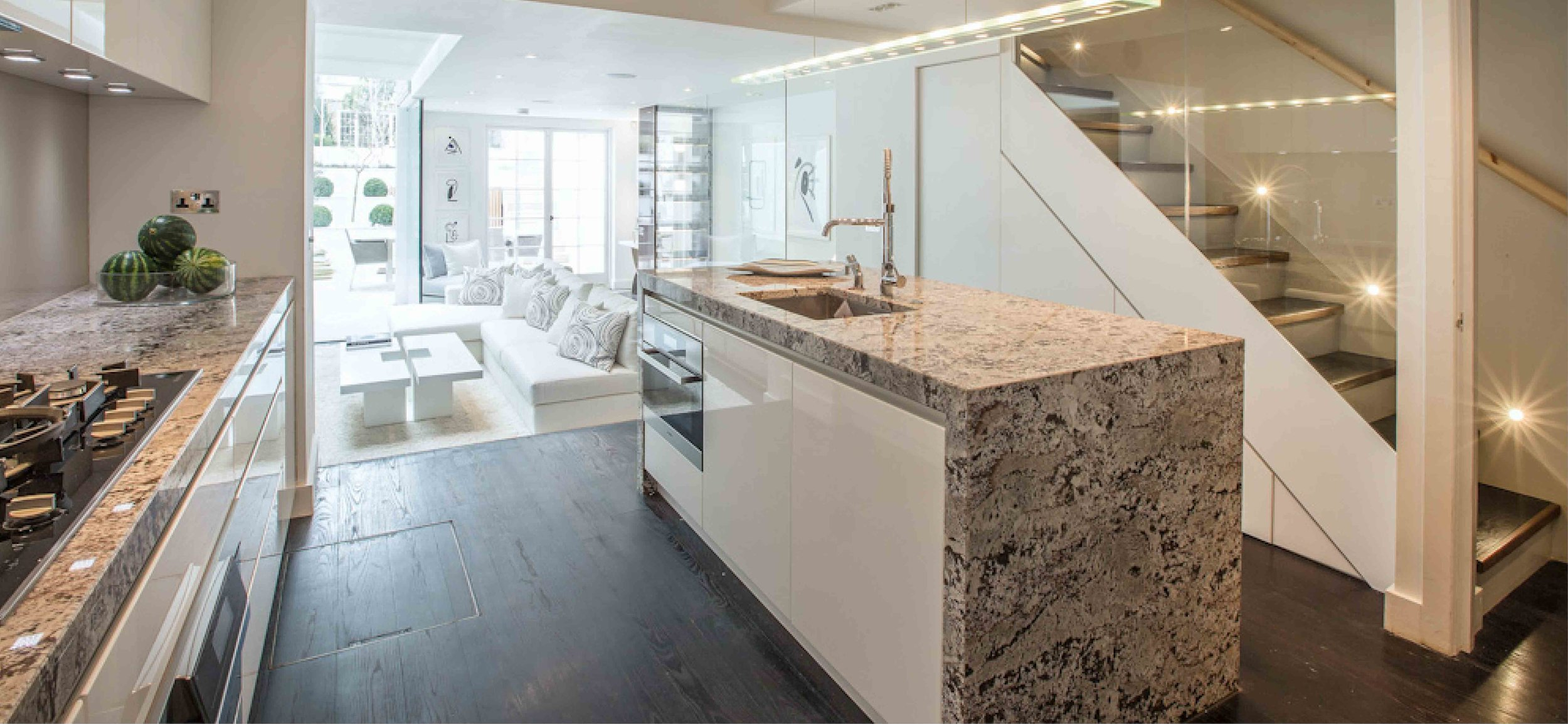 ___ marble worktops finish this modern kitchen. The island contains the oven and sink. The space leads into the new extension creating the main living space for the property,