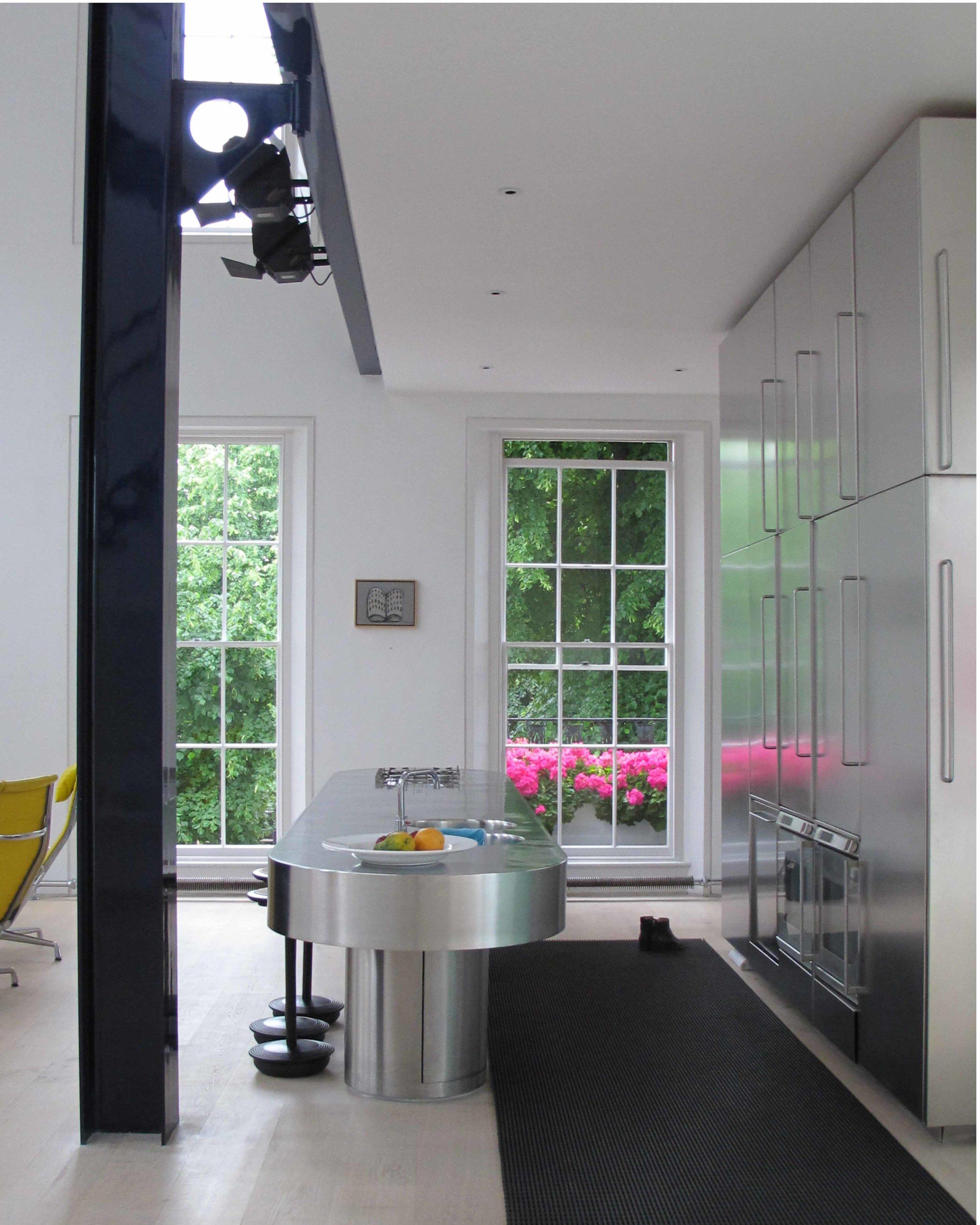 The kitchen. Polished stainless steel, dinesen floor boards. Georgian terrace house refurbishment.