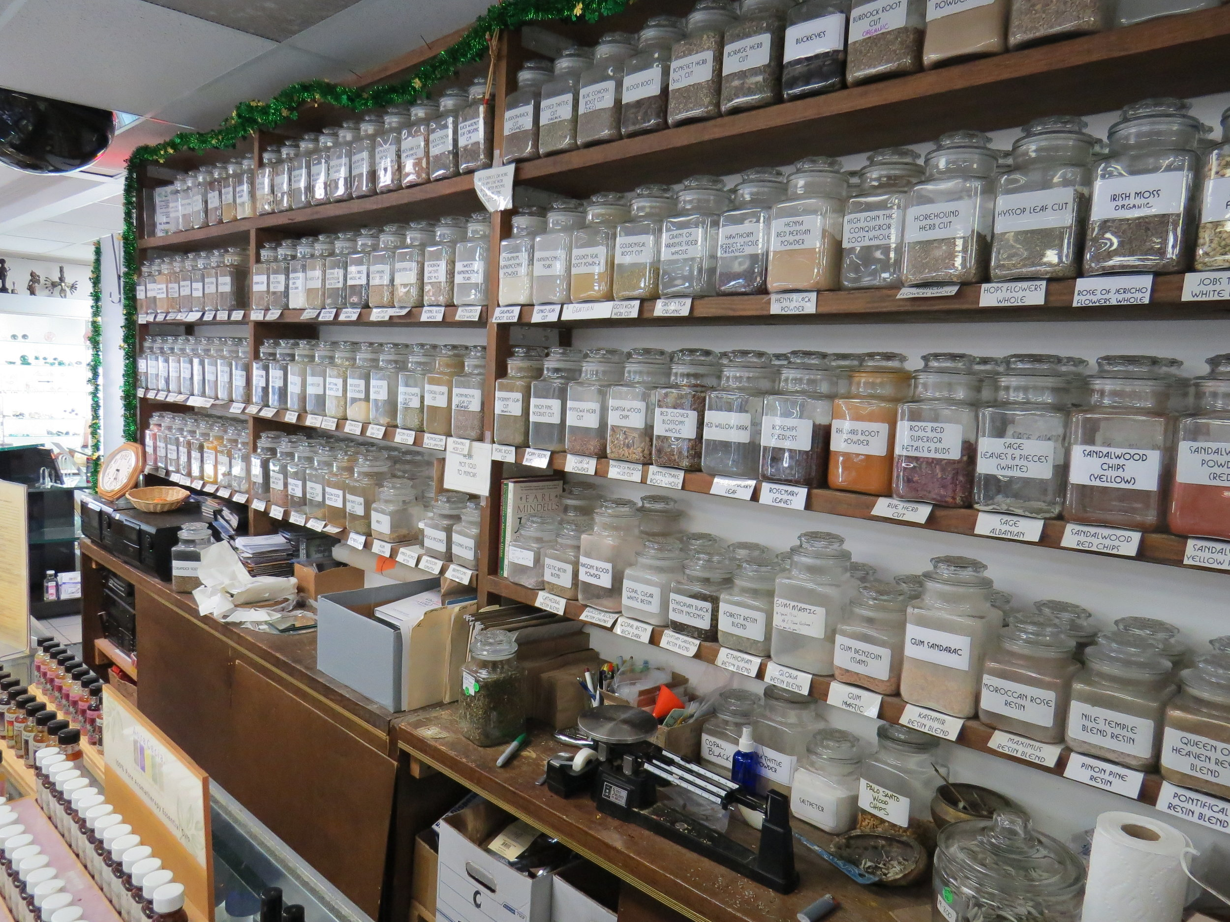 Wall of crushed herbs and roots. Pathways New Age Books and Music. Photo by Diva Norton.