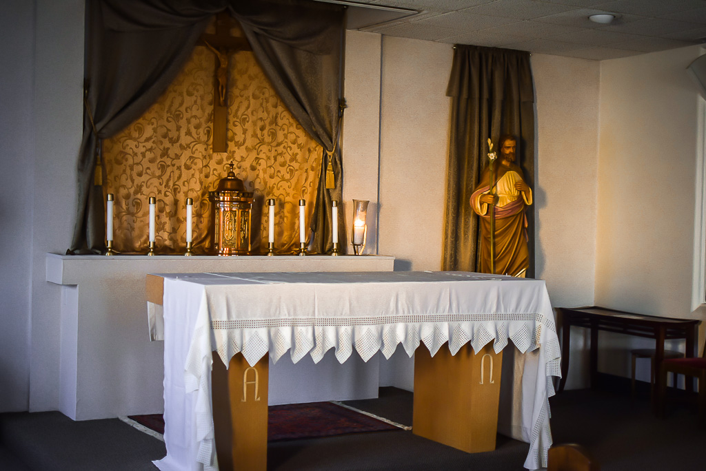 The altar inside the chapel of Father Jim's Home. This is where service is held every week and a symbol of piety and faith to many who enter the home.