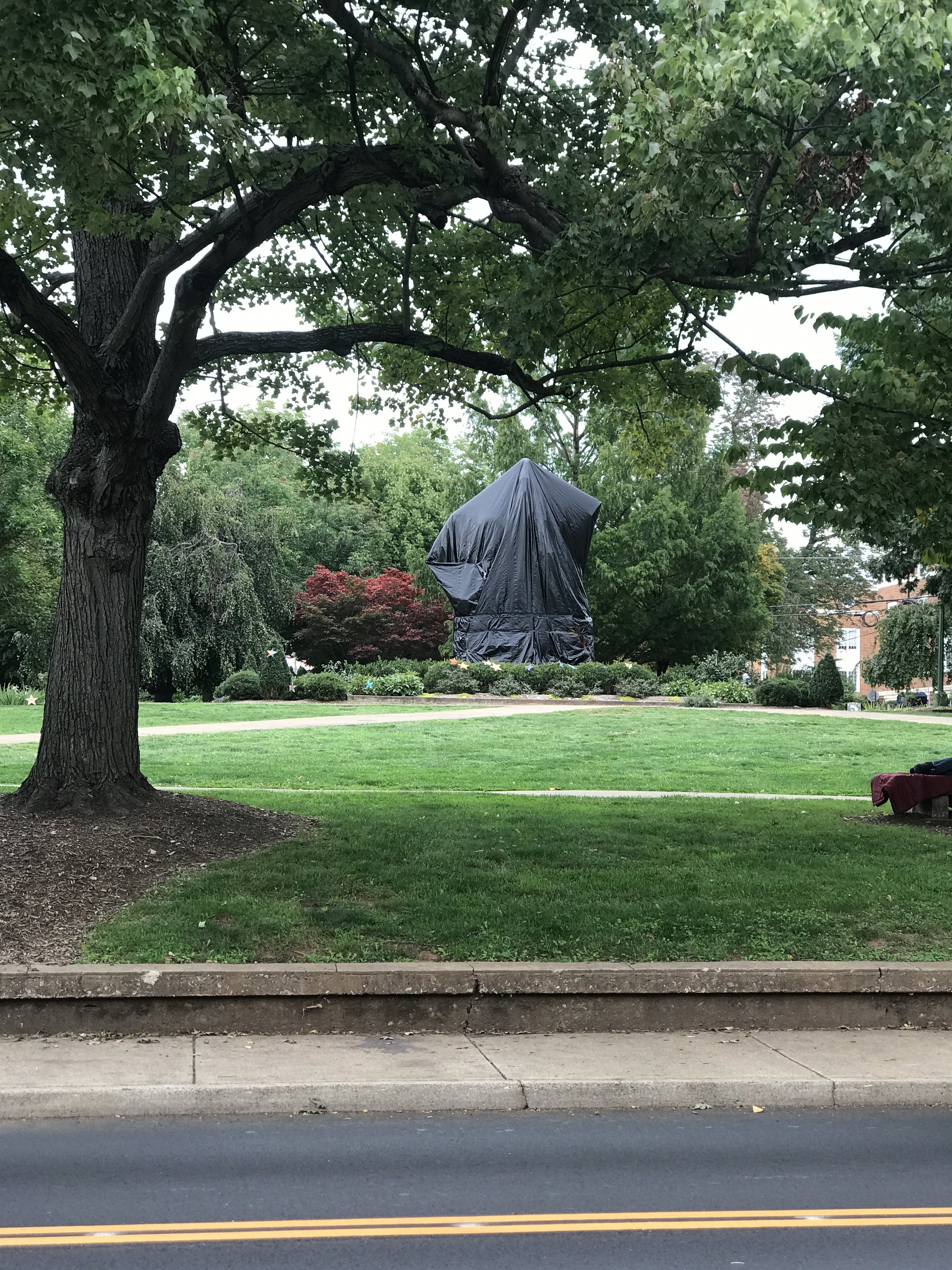 A black tarp shrouds the Lee statue in Emancipation Park. Photo courtesy Law Weekly.