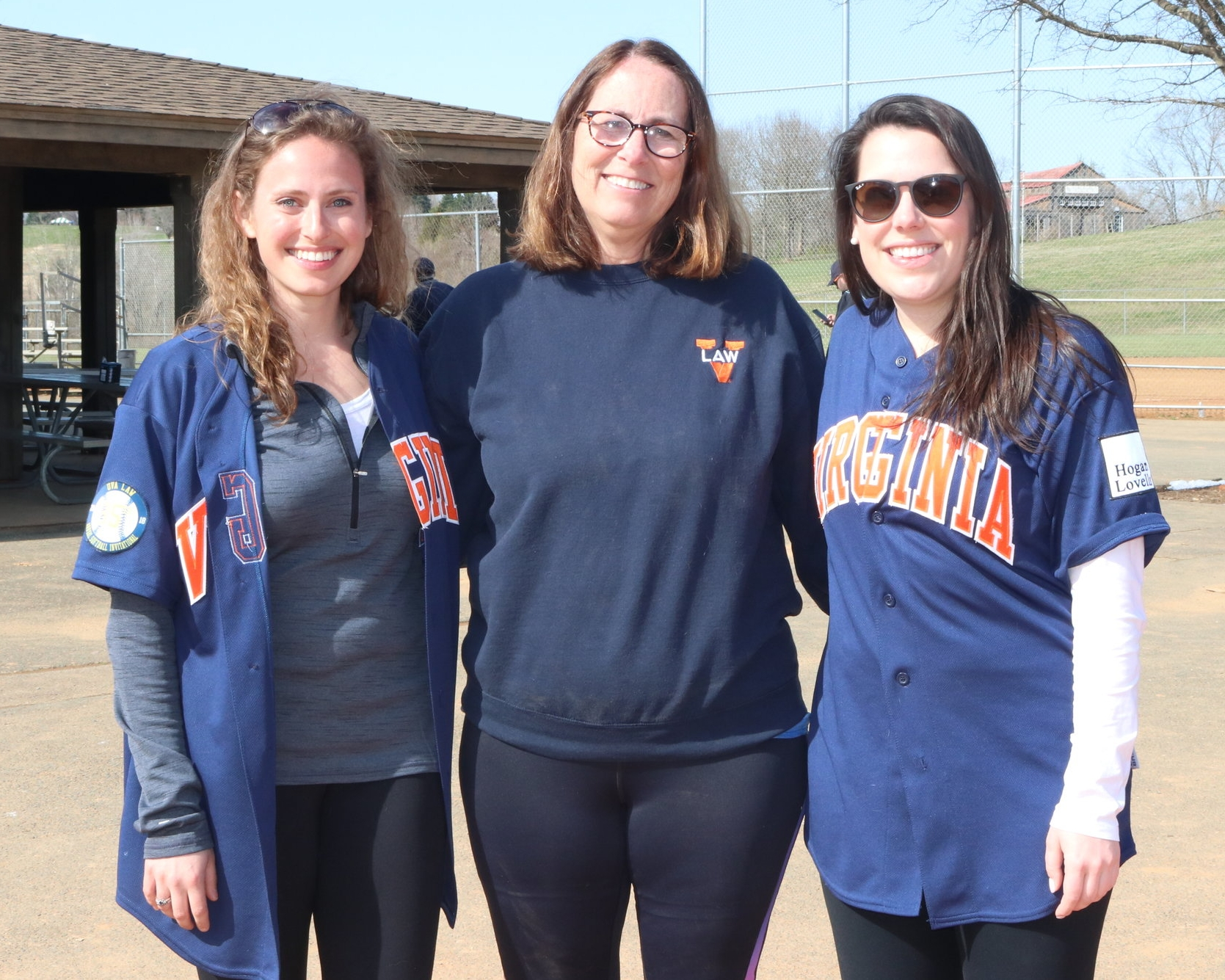 Tournament organizers Dascher Pasco '18 with Laura Gregory '18 and original softball tournament organizer Mary Wood Schmalzl '84. Photo courtesy Mary Wood Schmalzl.