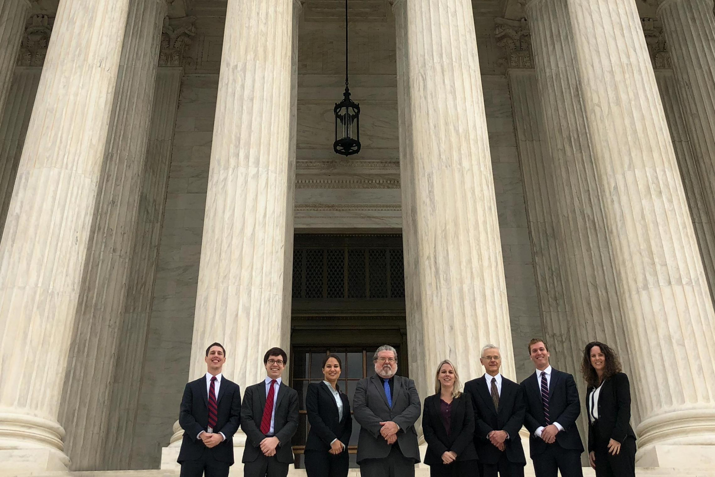 The UVA SCOTUS Clinic poses for a photo on the steps of the Supreme Court. Photo University of Virginia.