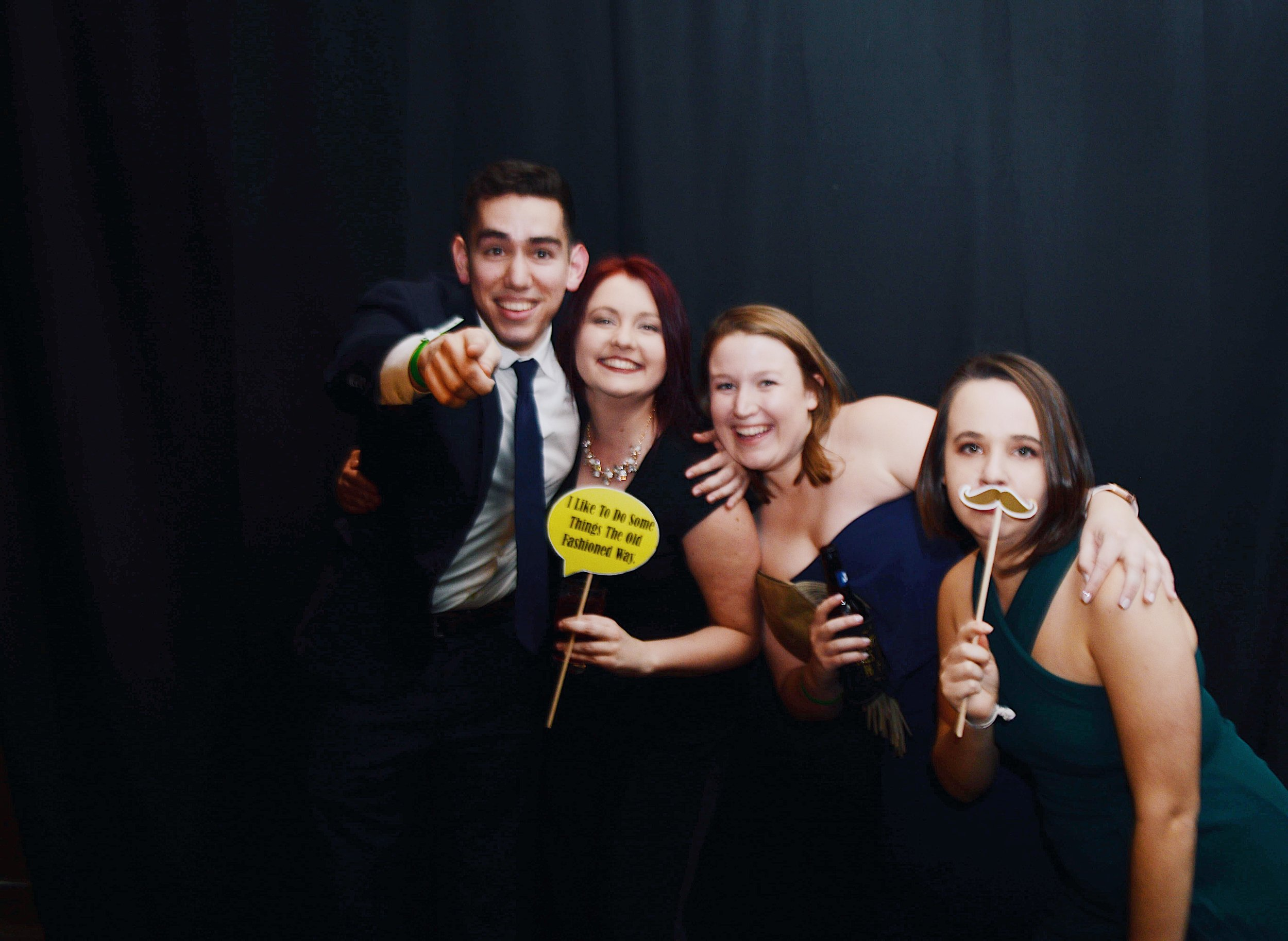 Daniel Natal '19, Gabriela Wolk '19, Maggie Echols '19, and Alyssa Daniels '19 pose for the Law Weekly's camera with their very cool props. Photo Credit Koleen Gladden '21.