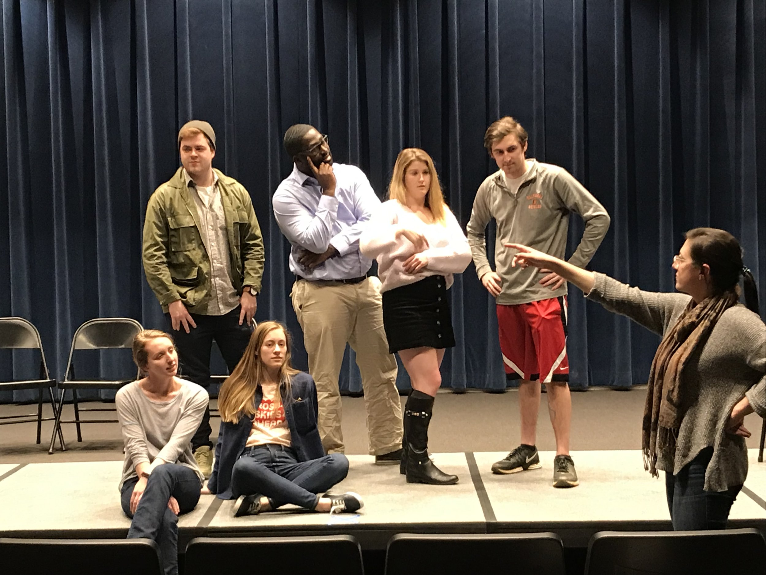 Nicole Llinares '19 gives stage directions to a group of actors. Photo credit Kim Hopkin '19.