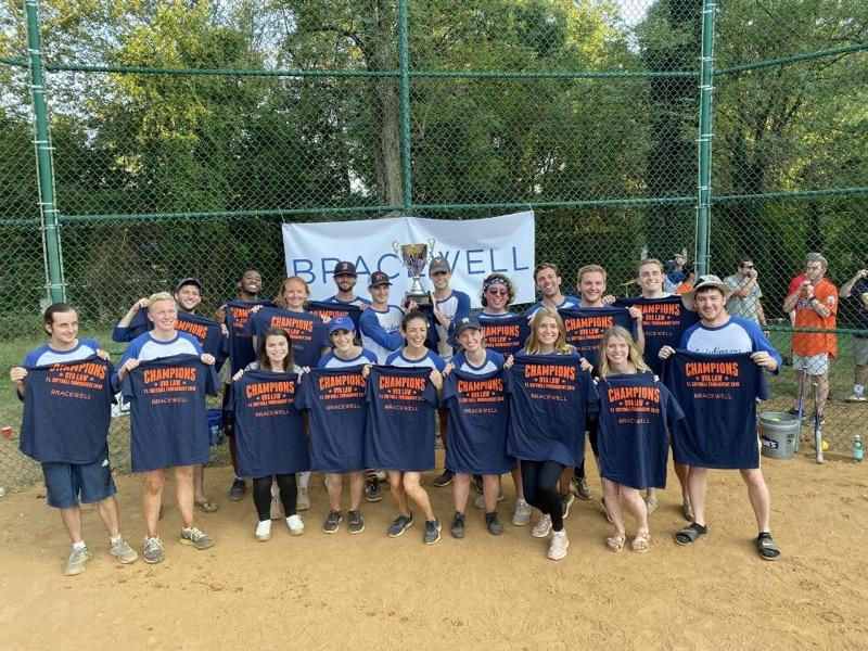 Section J flaunts their championship wares after capturing the 1L Softball Tournament title. Photo credit Zac Bell '21