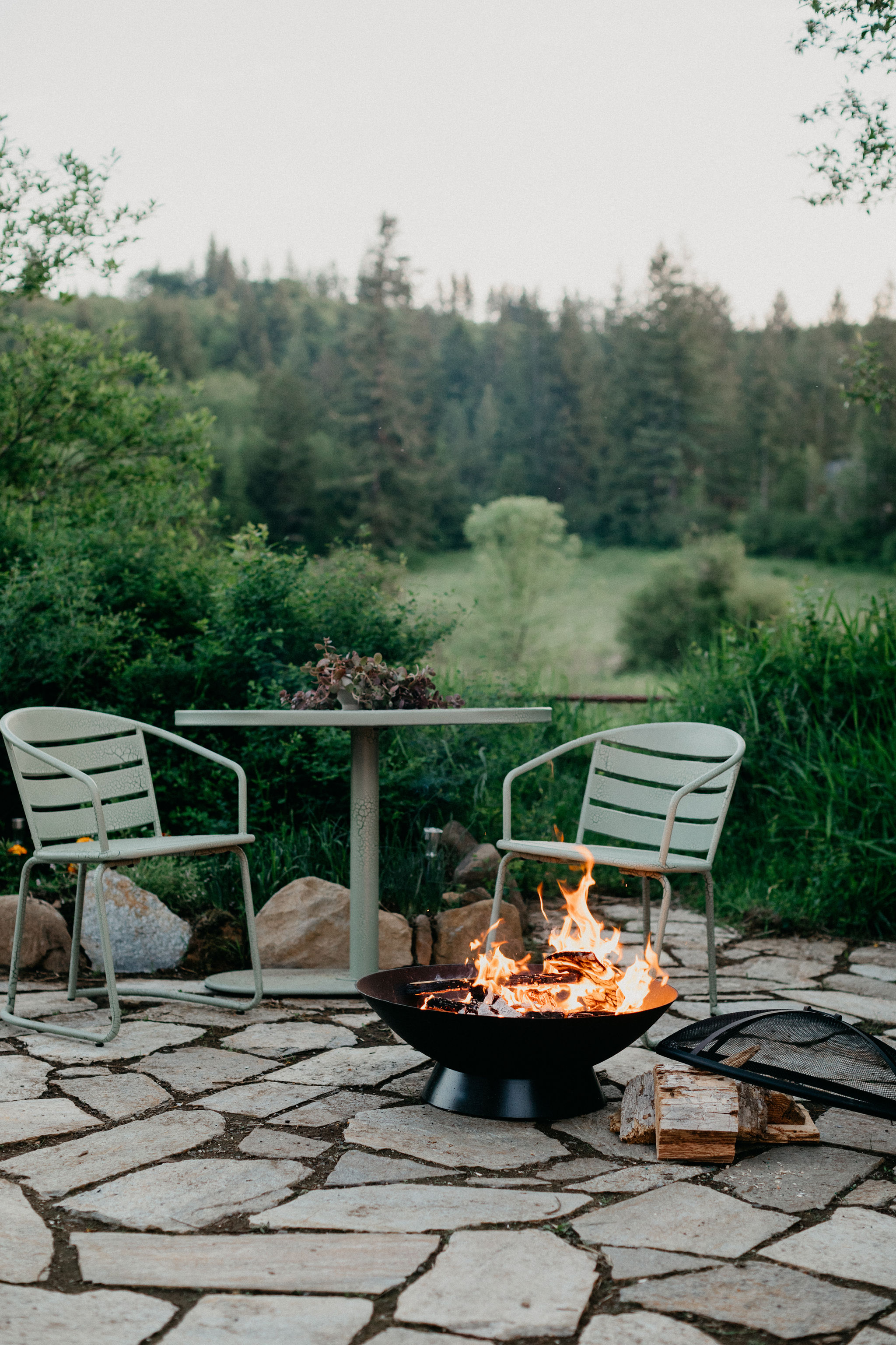 Outdoor fire-pit, chairs and table to enjoy the beautiful mornings and evenings.
