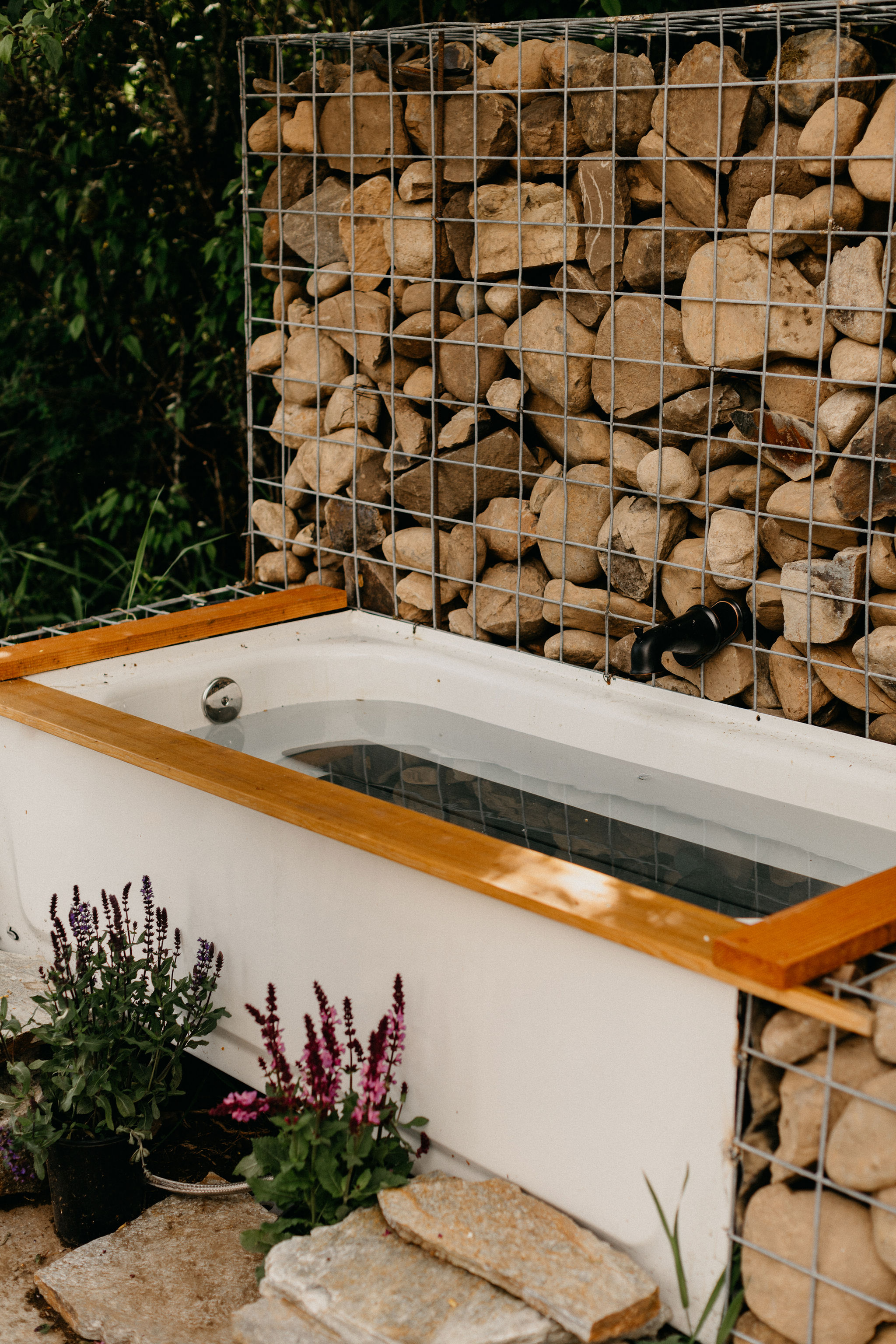 Outdoor heated bathtub to soak and relax after a long hike.
