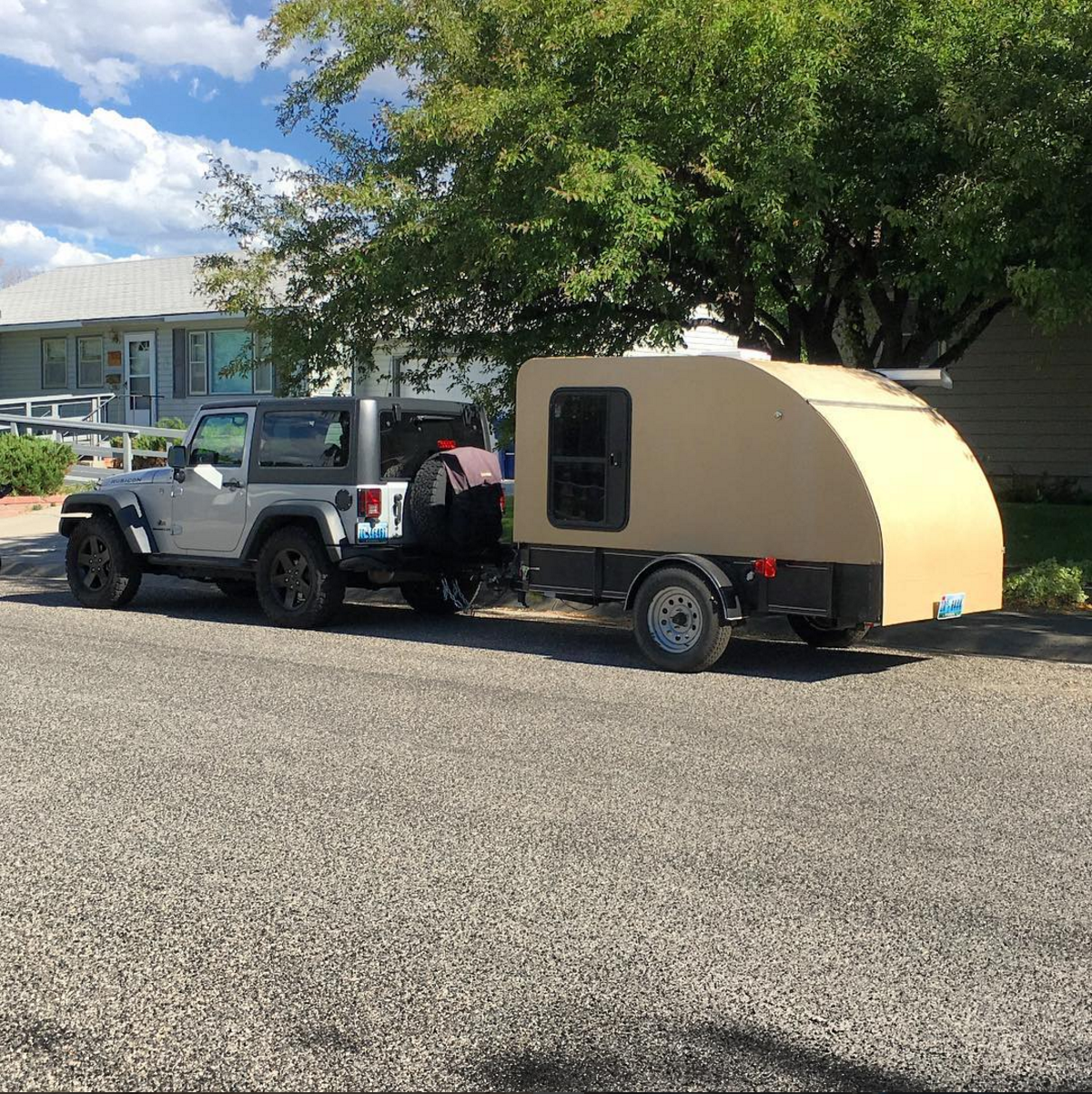 I built this teardrop camper in my garage while we lived in Alabama. It weighed less than 1,000 lbs, or about half of the 2 door JK's towing capacity. To put things in perspective, the RAM's  payload  is 500 lbs greater than the JK's  towing  capacity!