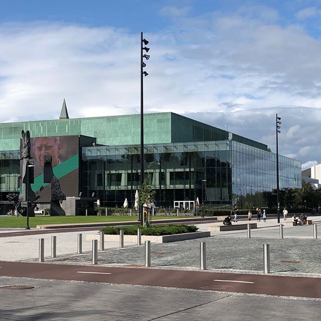 This is the recently opened green Concert Hall on a grand civic open plaza in Helsinki. It is opposite the Oodi Library.