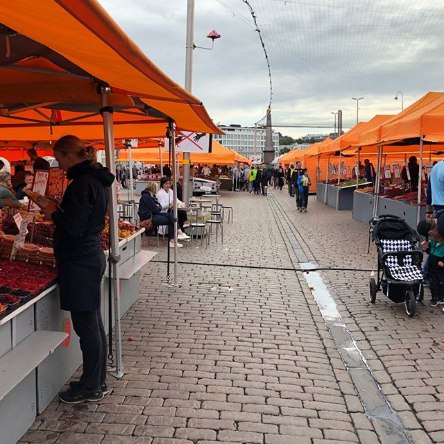 This is a daily market for food and crafts at Kauppatori on the harbor's edge in Helsinki.