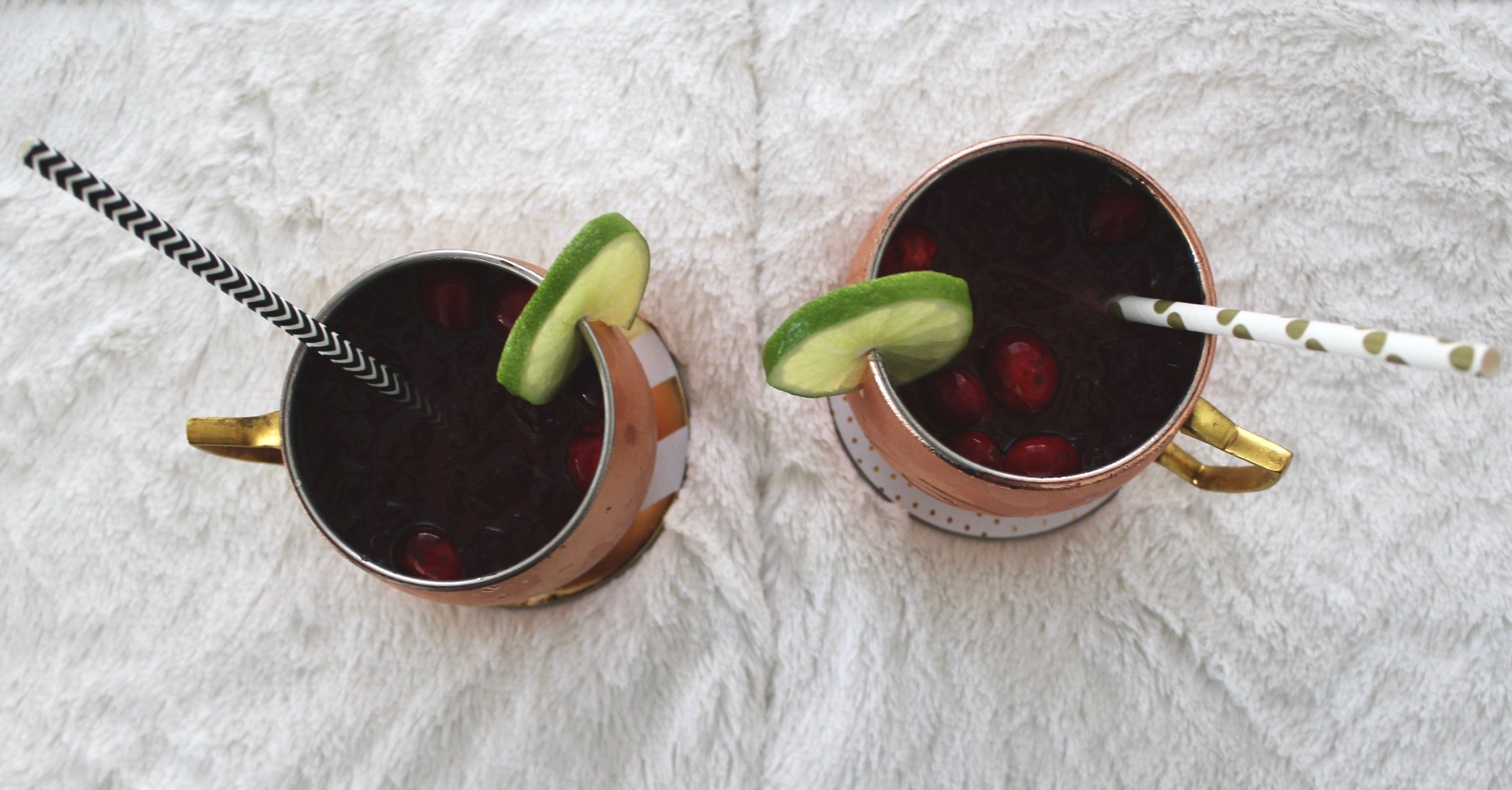 Cranberry Moscow Mules/ Garnished with Lime severed in copper mugs and polka dot paper straws