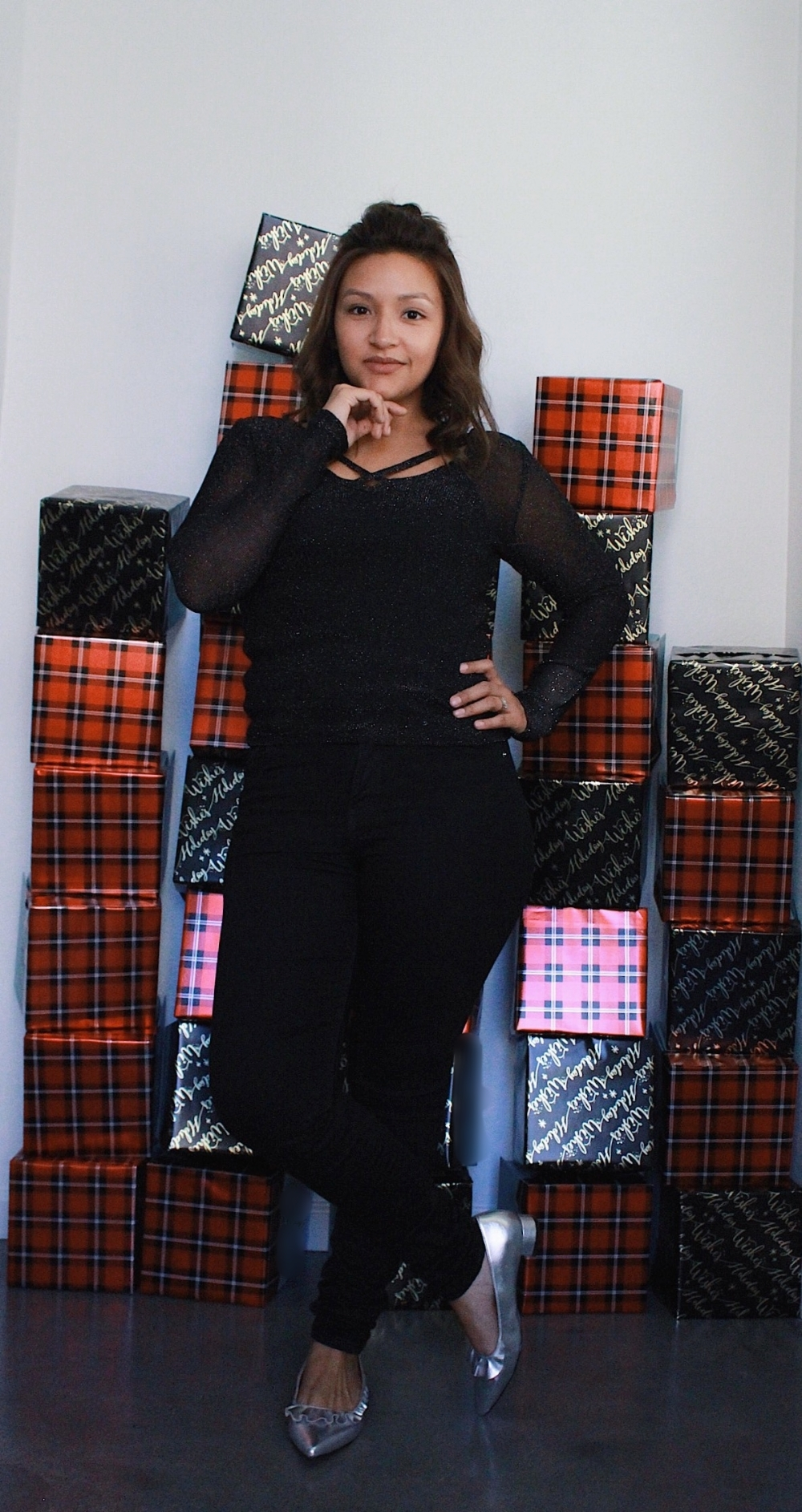 Women's black outfit with silver shoes