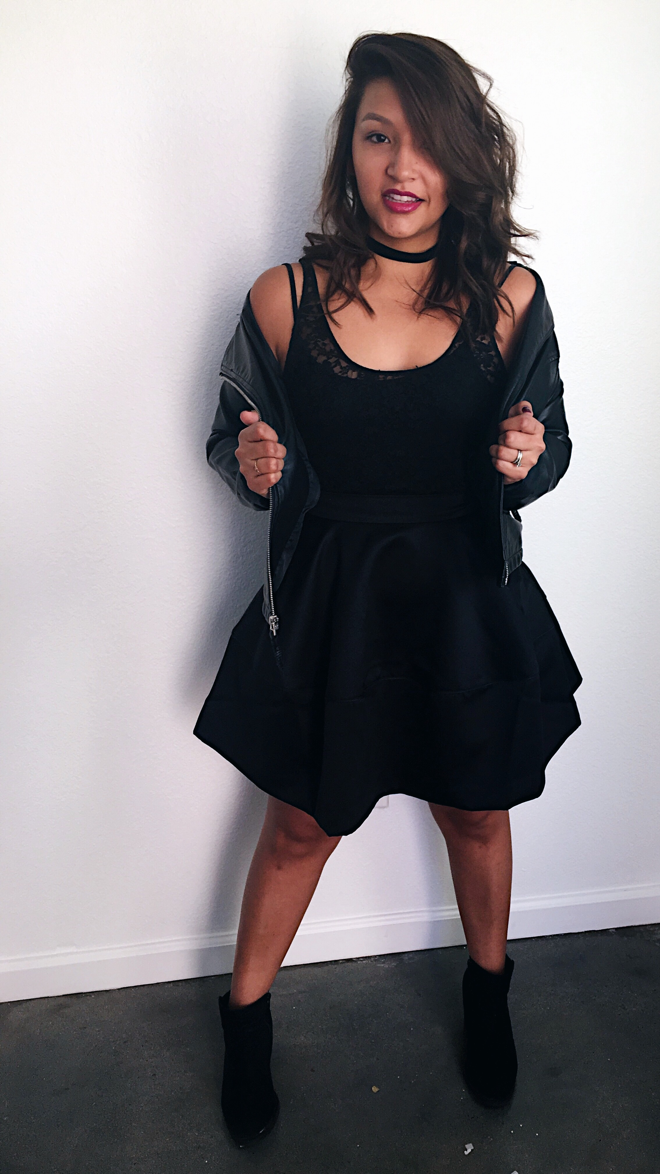 Holiday Party Fashion/ Lace Bodysuit with satin skater skirt/ Black suede choker/ black ankle boots and leather jacket