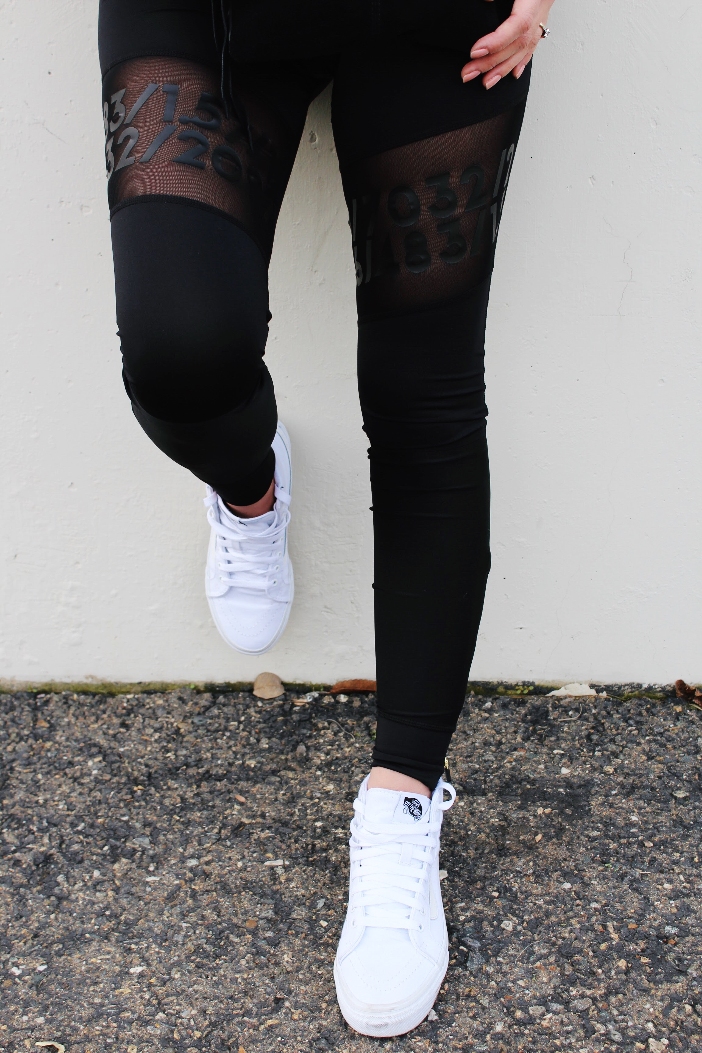 Black Leggings with Mesh Details and Classic SK8-Hi White Vans Shoes