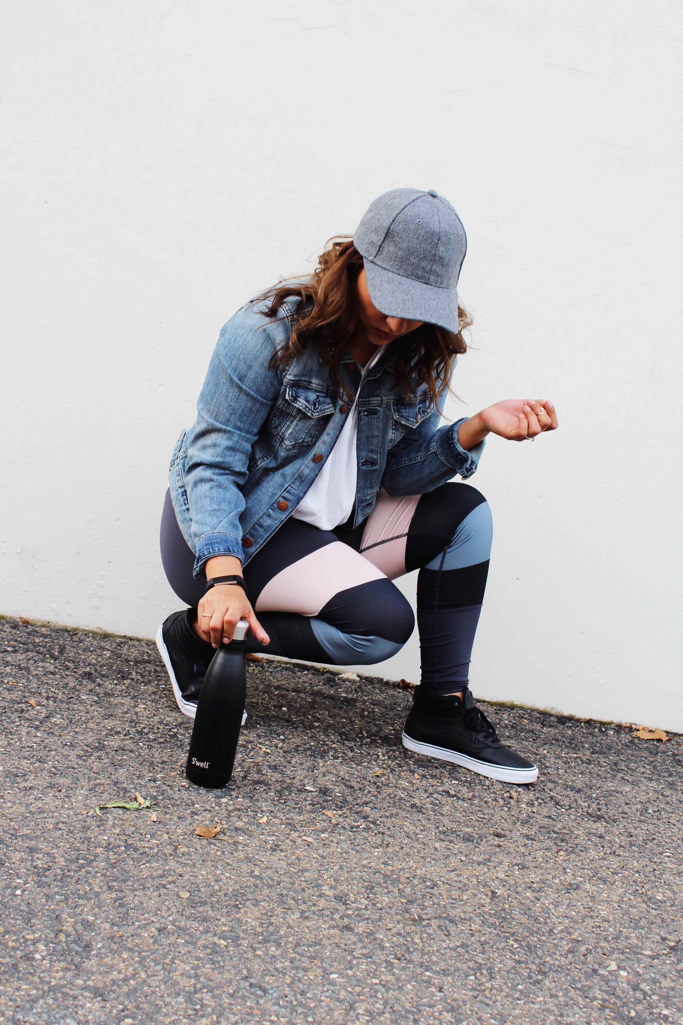 Grey Wool Baseball Cap with a denim jacket and stripped yoga pants. Swell Bottle and Black  Pleather SK8- Hi Vans