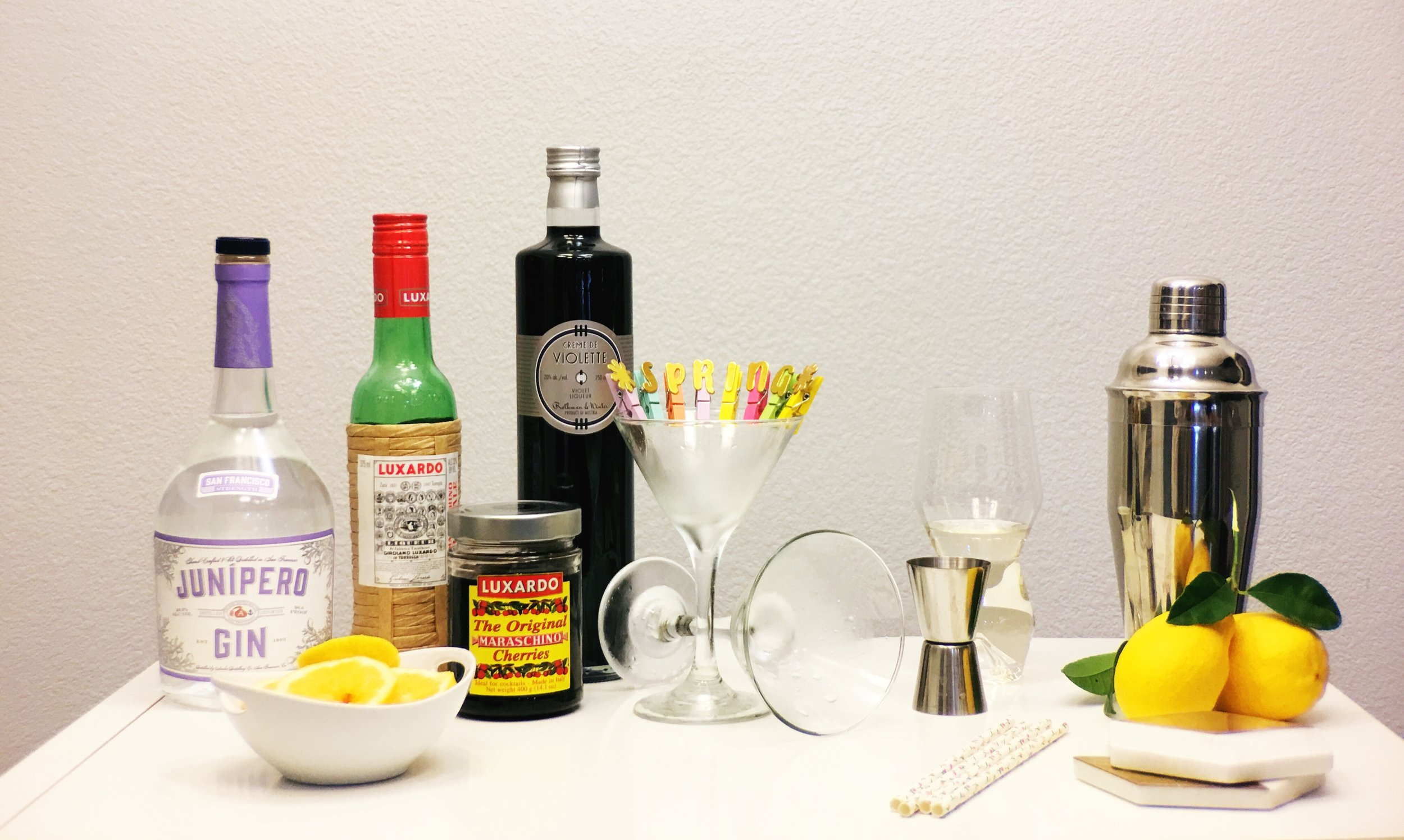 Ingredients for an Aviator Cocktail. Junipero Gin, Luxardo Marachino Liqeur, Creme De Violette and lemons