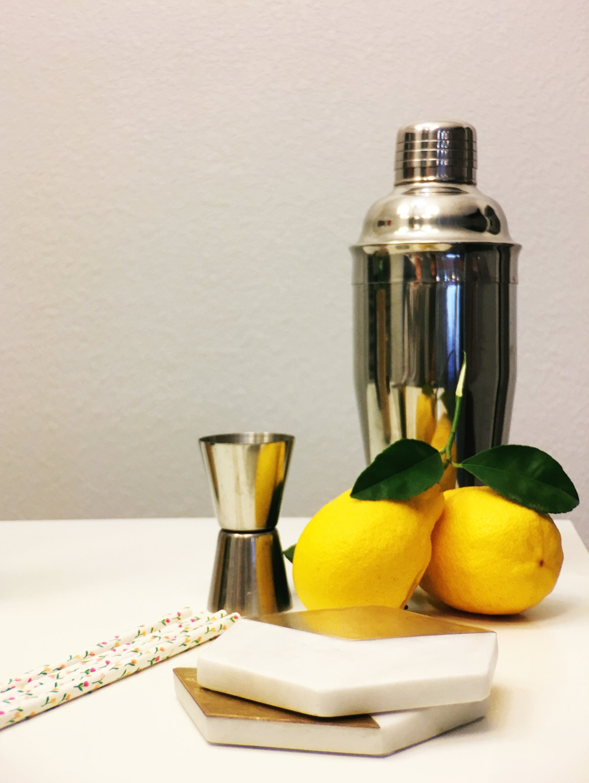Fresh Lemons and Shaker with Paper Straws