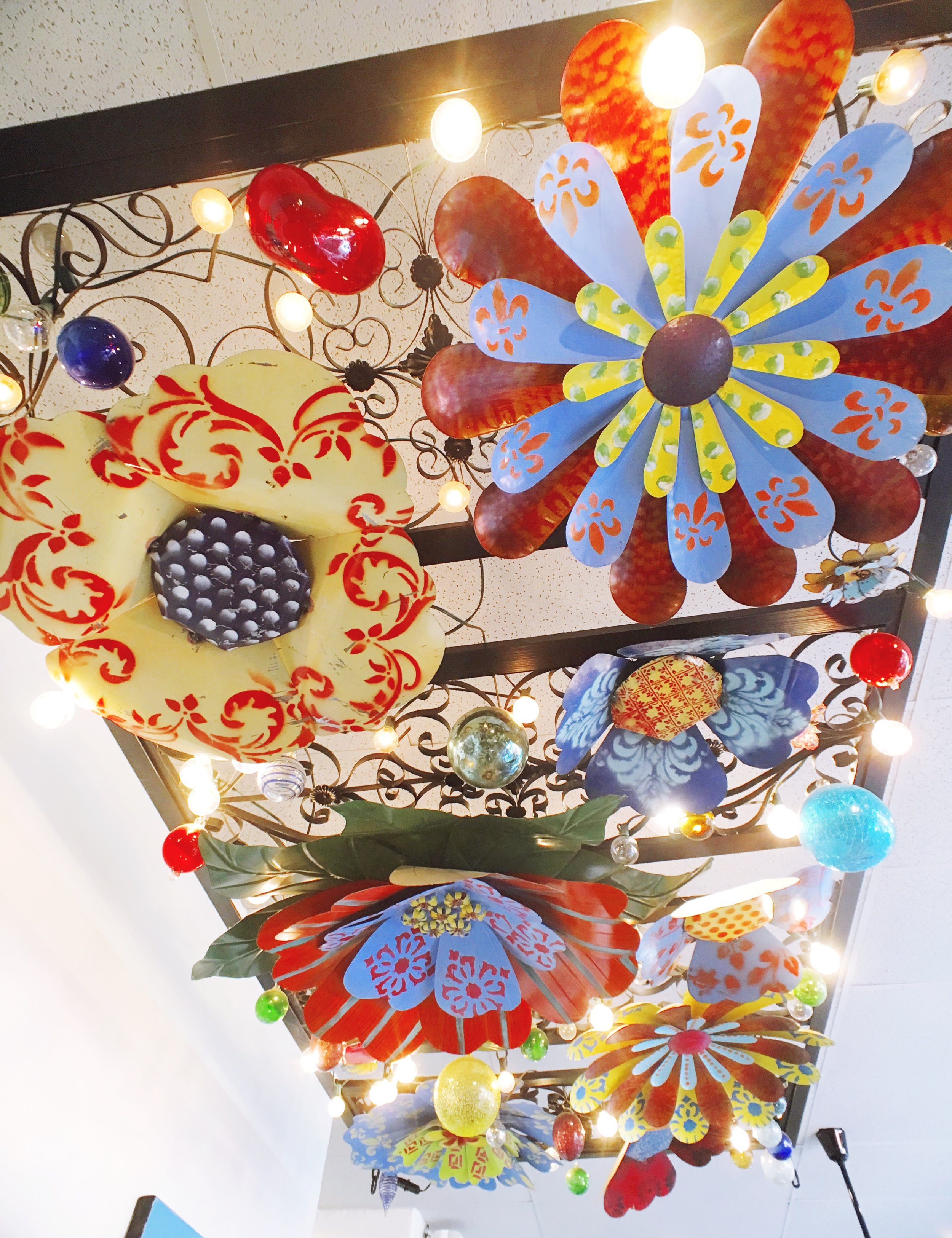 Metal Flower Ceiling art installation at La Mo Cafe in Turlock, CA