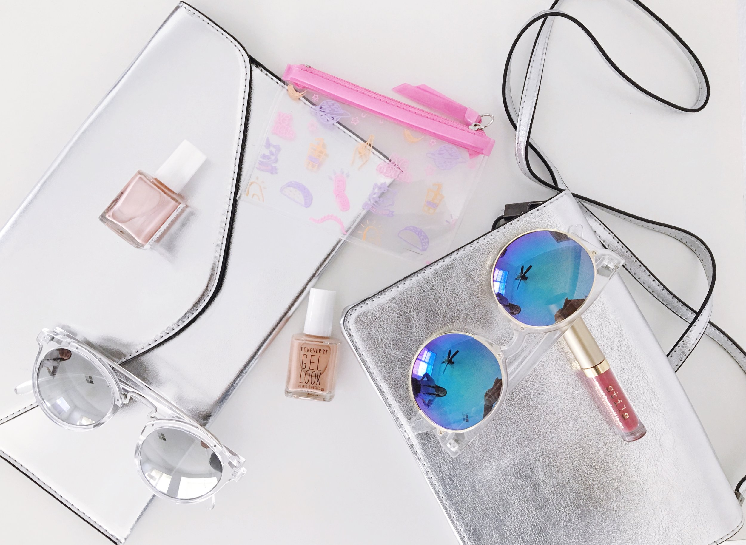 Spring Essential Accessories. Metallic Shoulder Bags and Sunglasses with Clear frames and  Polarized lenses. Pastel Nail Polish in Millennial Pink and Patina Stila All Day Liquid Lipstick.