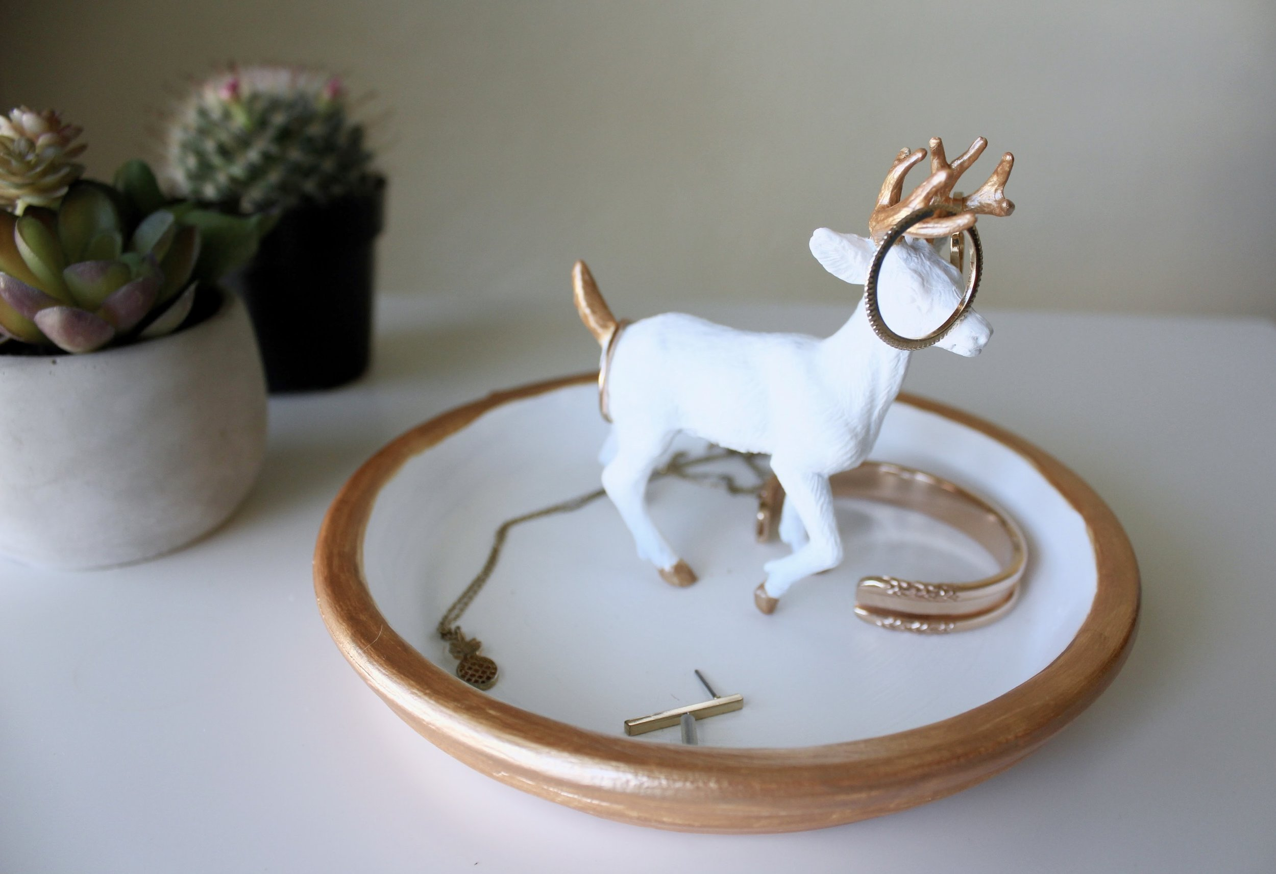 Succulent and Cactus displayed with a finished DIY Jewelry Dish with a Deer Figurine. Gold Jewelry Displayed including Maria Shireen Floral HairTie Bracelet.