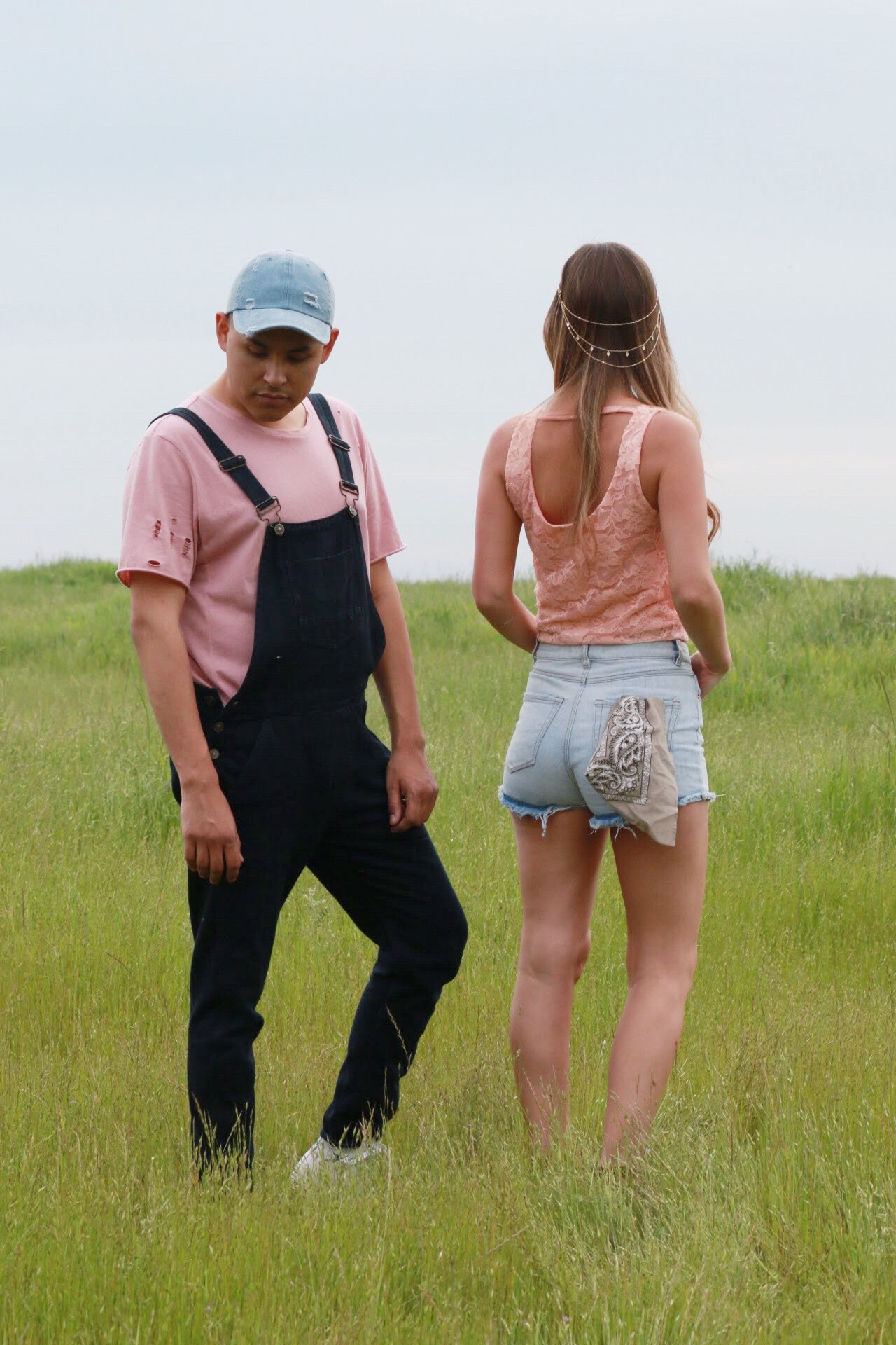 Men's Festival Fashion includes Overalls and Distressed Basic Tees. Lace Tops and Denim Shorts with a Bandana and a gold chain hair accessory.