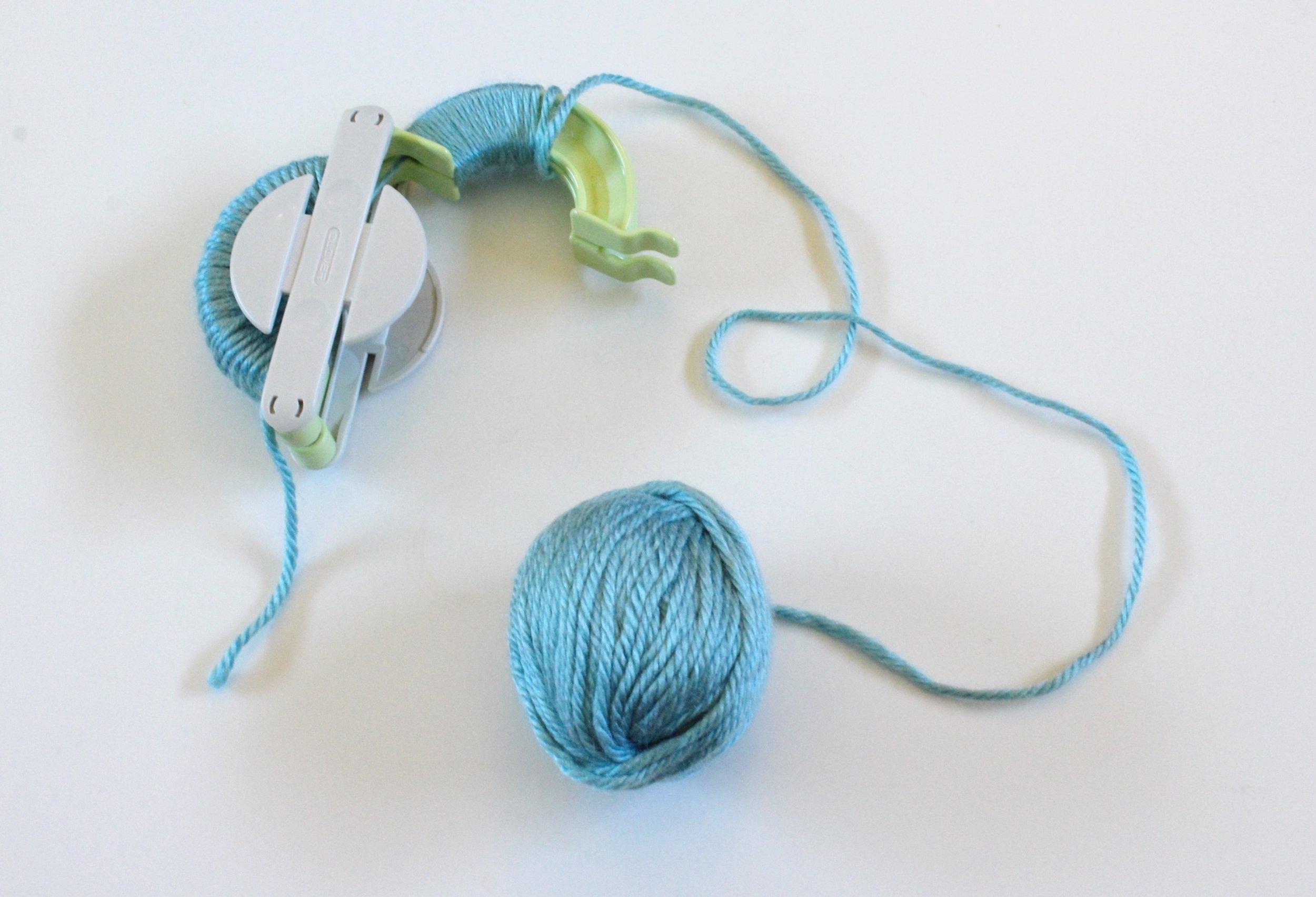 Clover Pom Pom Maker and Sky Blue Yarn