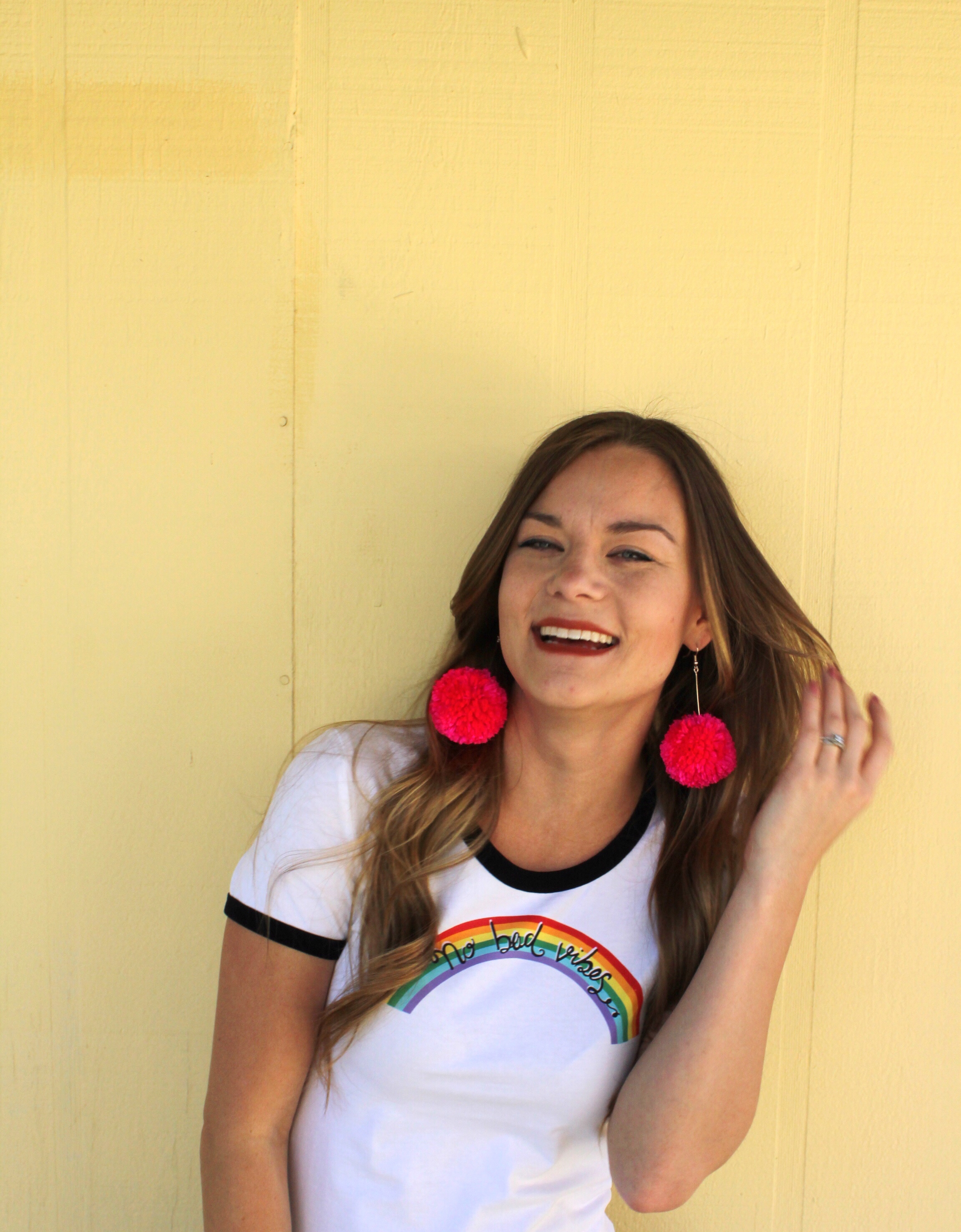Hot Pink Pom Pom Earrings and No Bad Vibes Rainbow 70's Style Ringer Tee
