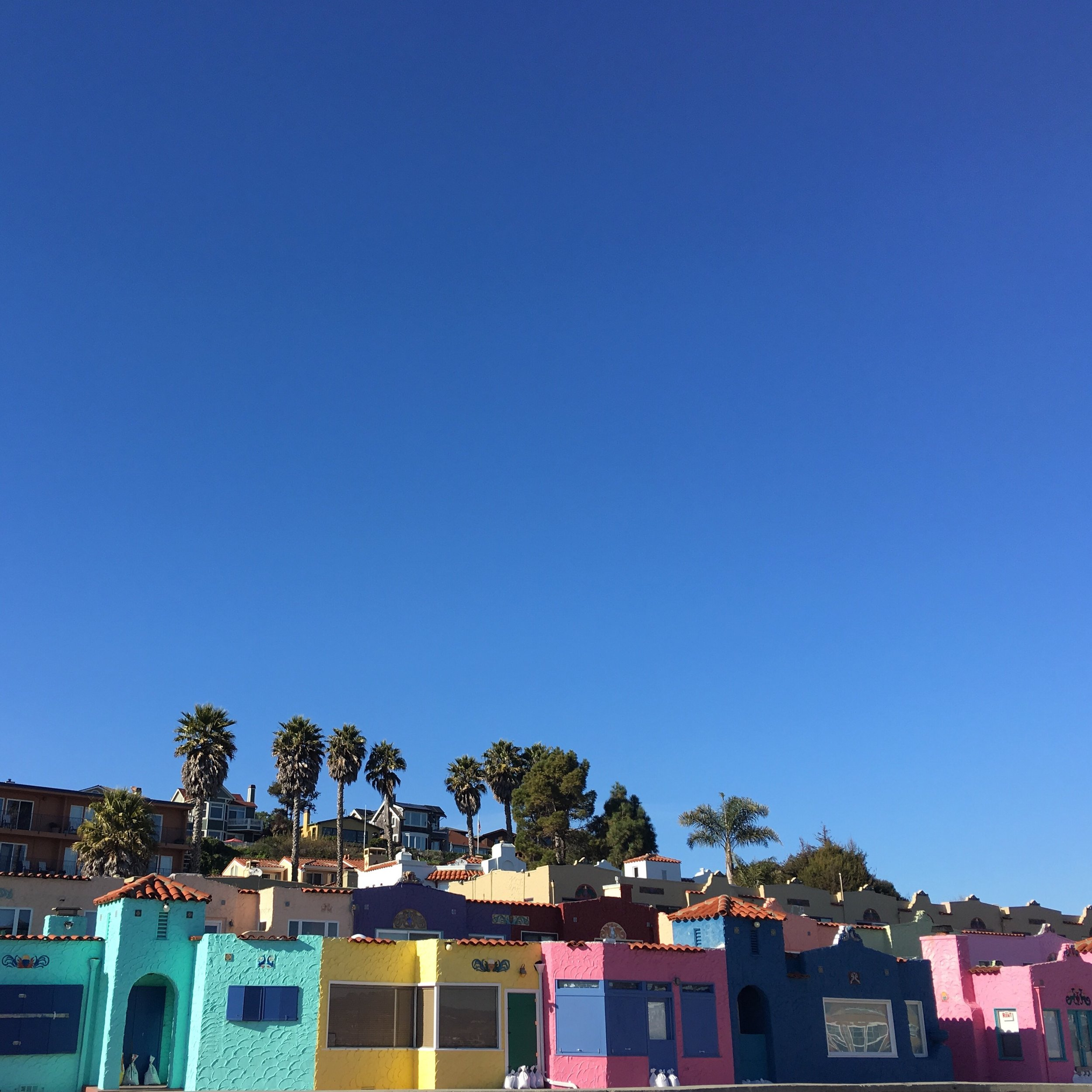 The Venetian Hotel at the Capitola Wharf in California. Bright Colorful Beach Buildings