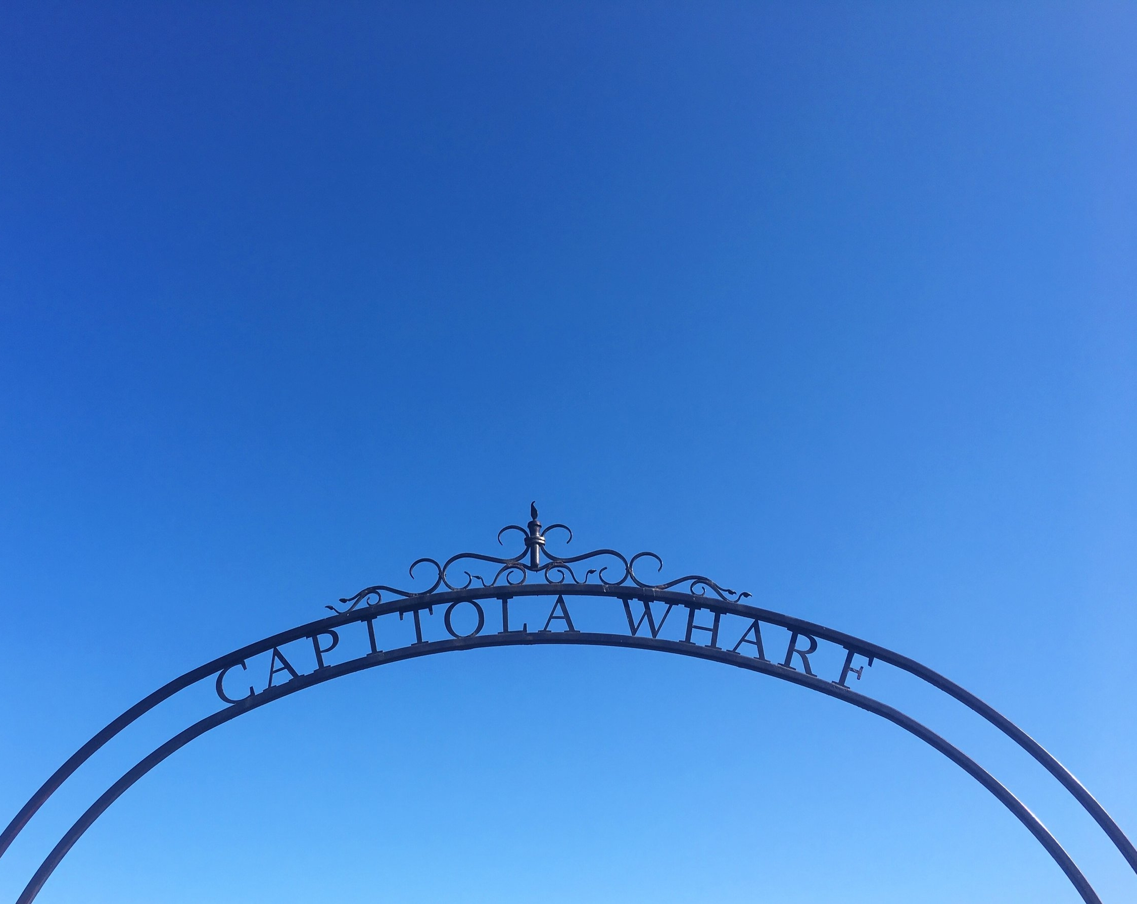 Capitola Wharf Arch and Blue Skies.