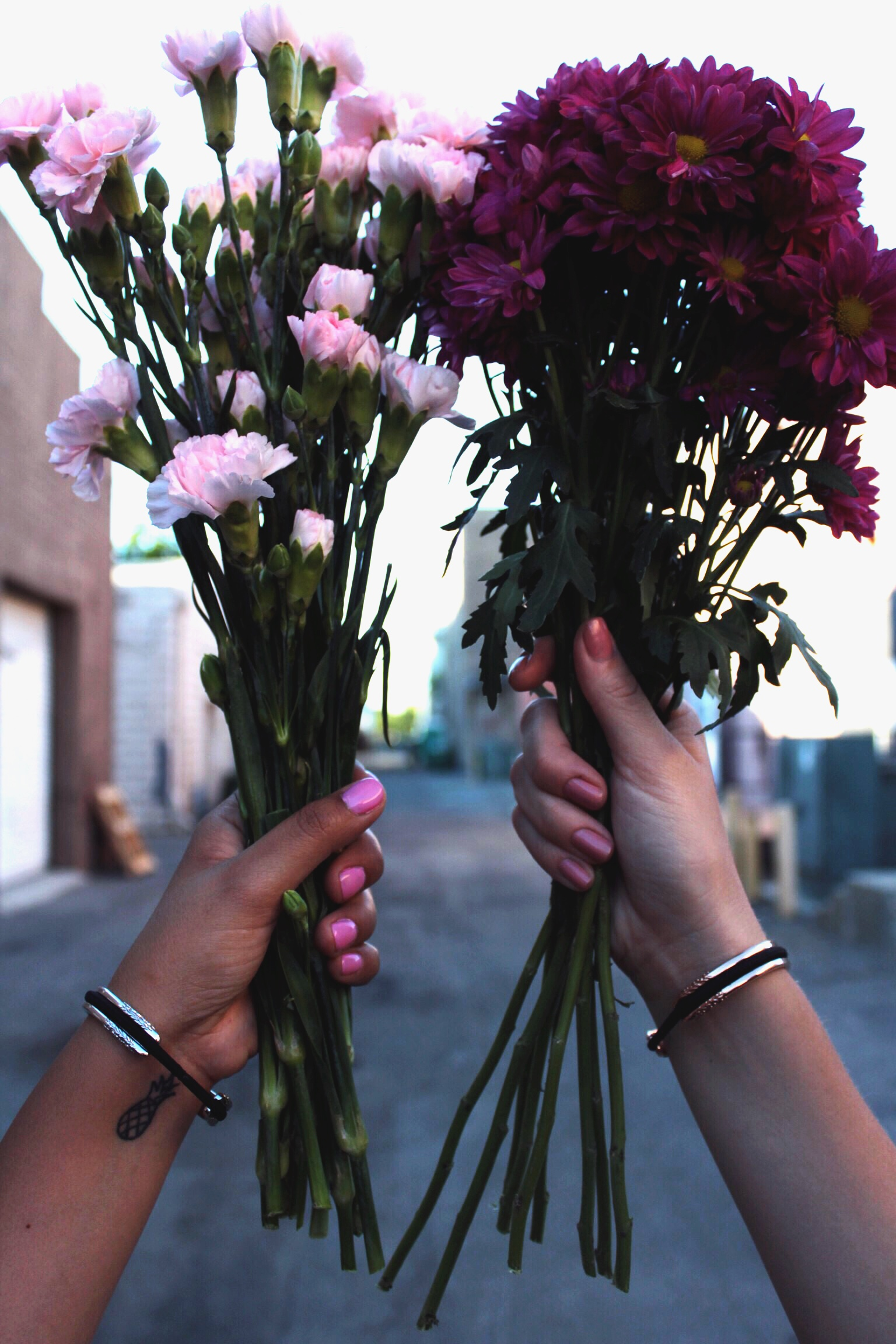Bouquet of Pink Carnations and Purple Daisy's. Maria Shireen Floral Design HairTie Bracelets.