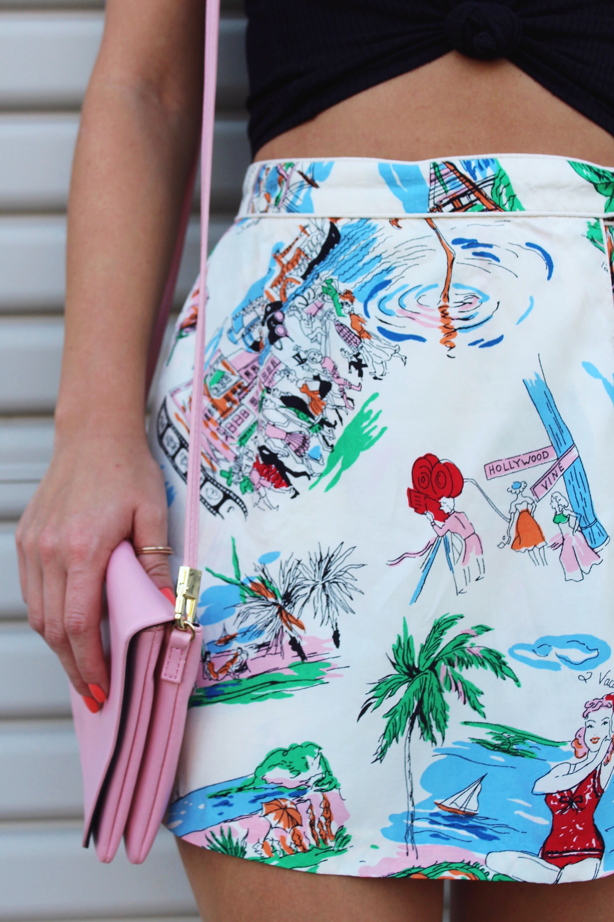 Pink Cross body bag and old Hollywood Fabric Printed Skort.