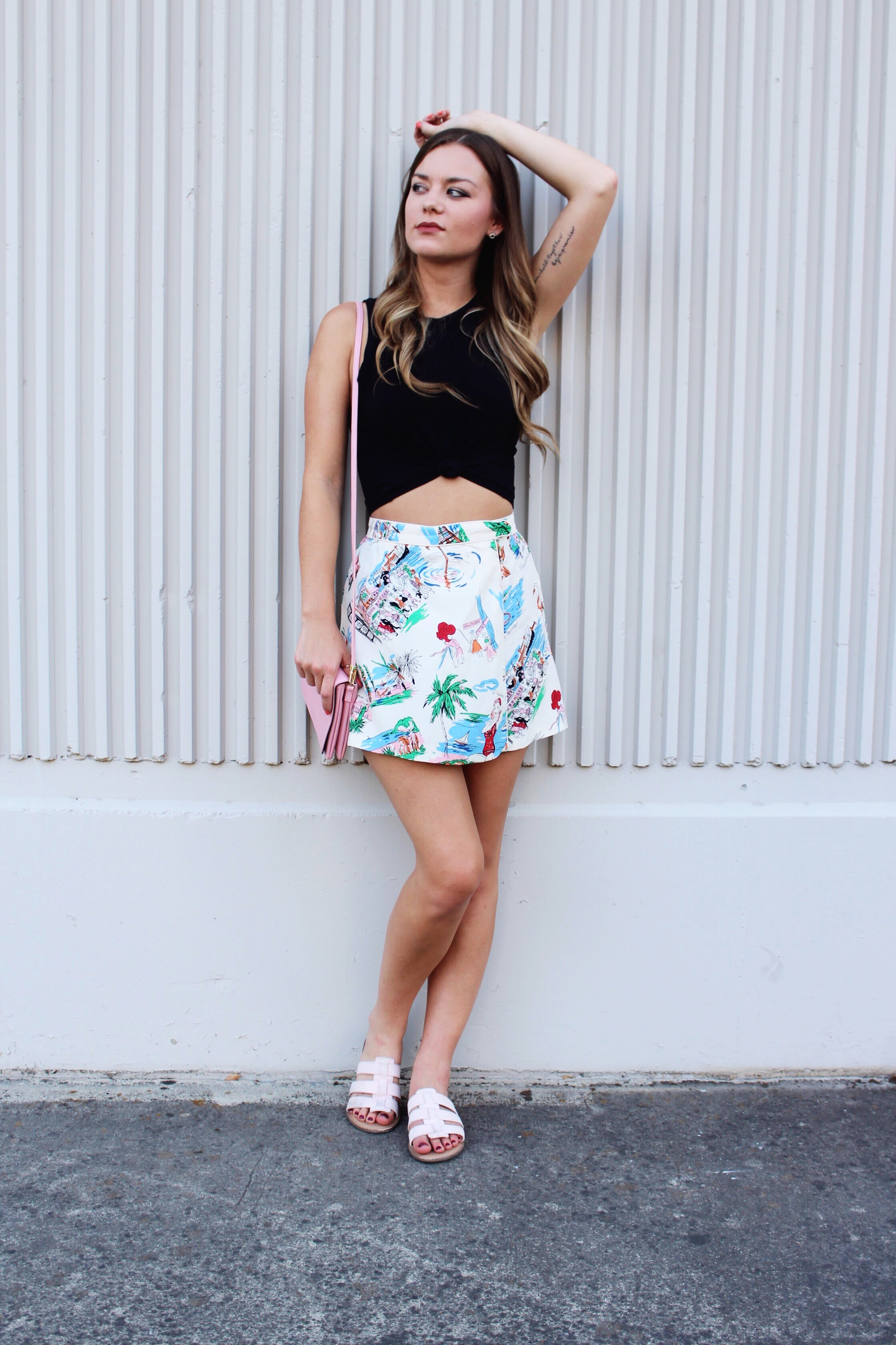 Black Knotted Crop Top with Old Hollywood Print Fabric Skort and Strappy Flat Slip On Sandals.