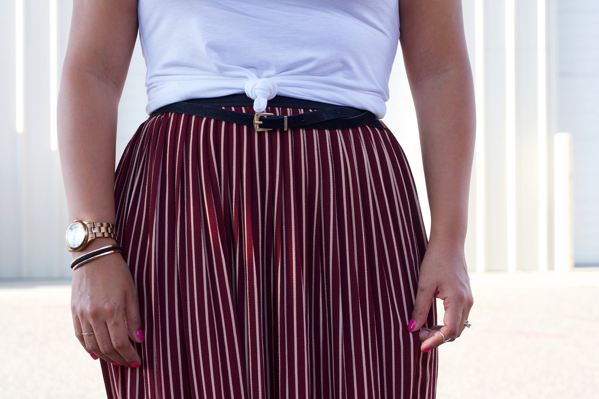 Maroon Stipe Skirt and Suede Belt. Basic White Tee and knot detail.