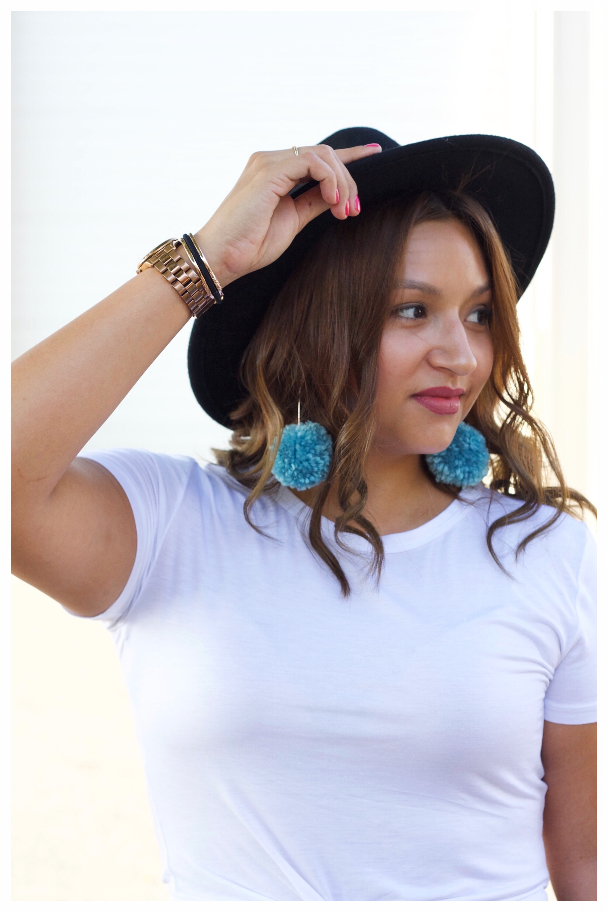 Blue Pom Pom Earrings and Gold Accessories