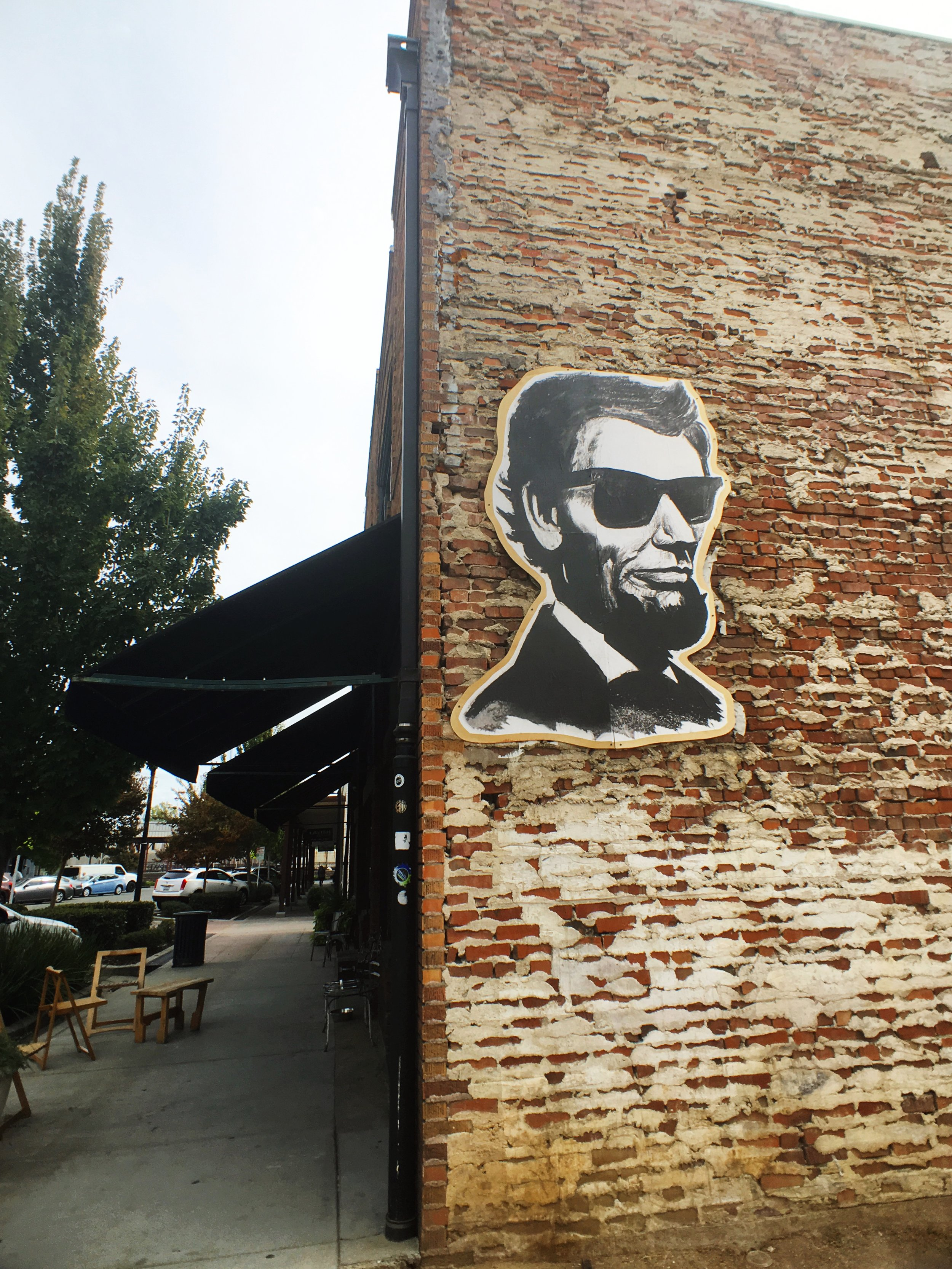 exposed brick building with Abe Lincoln sign