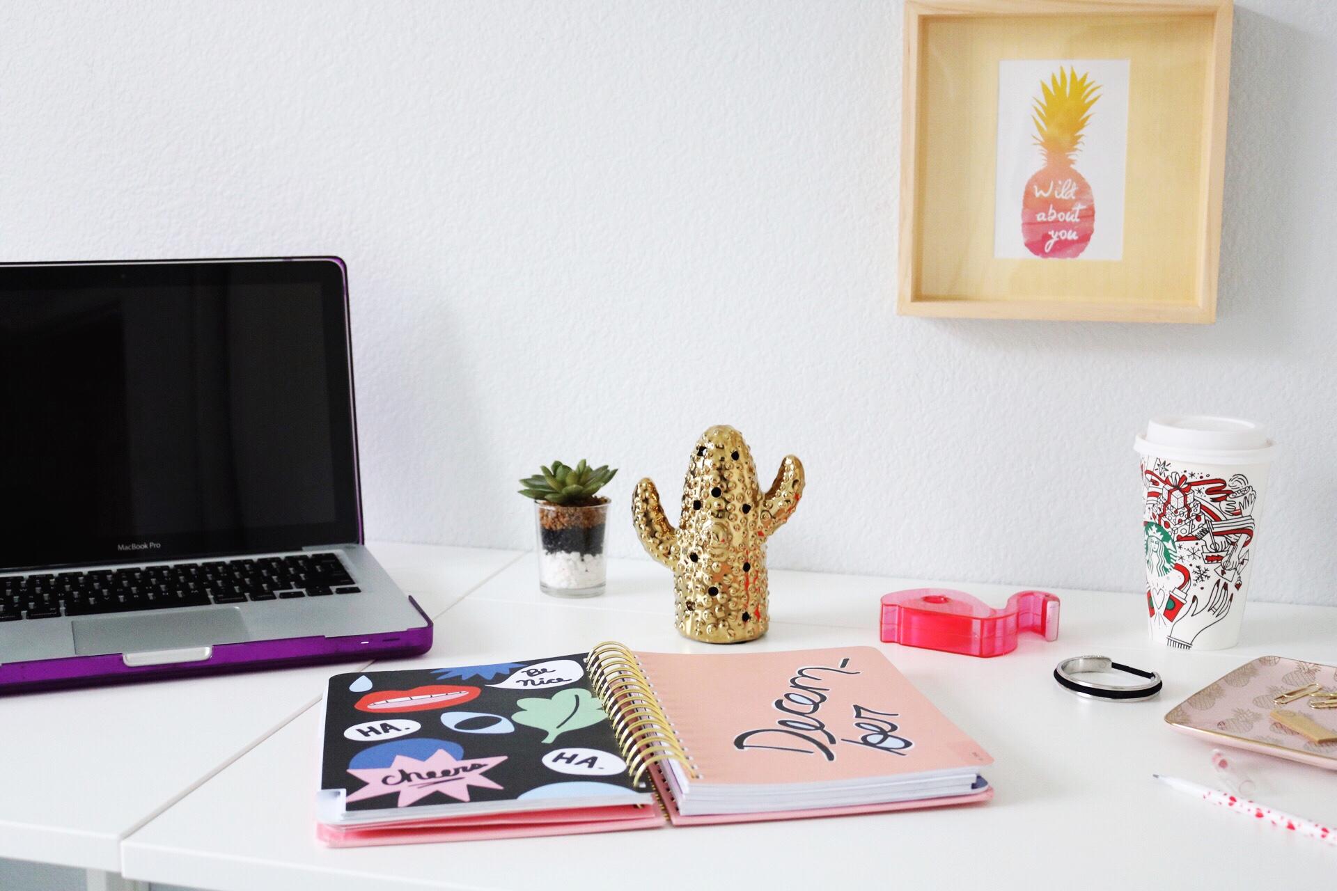 MacBook Pro Bando Planner flamingo tape dispenser gold cactus statue pineapple framed photo