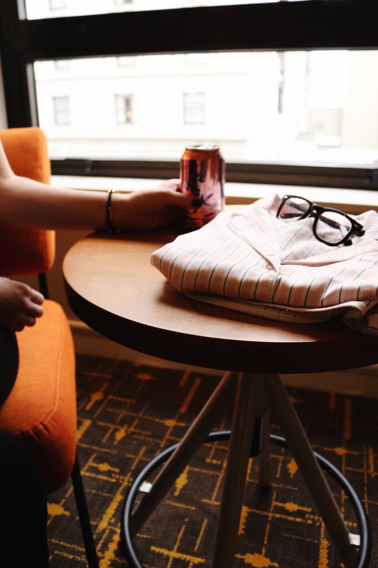 Striped pink pajama set, black rim glasses, La Croix, San Fransisco getaway