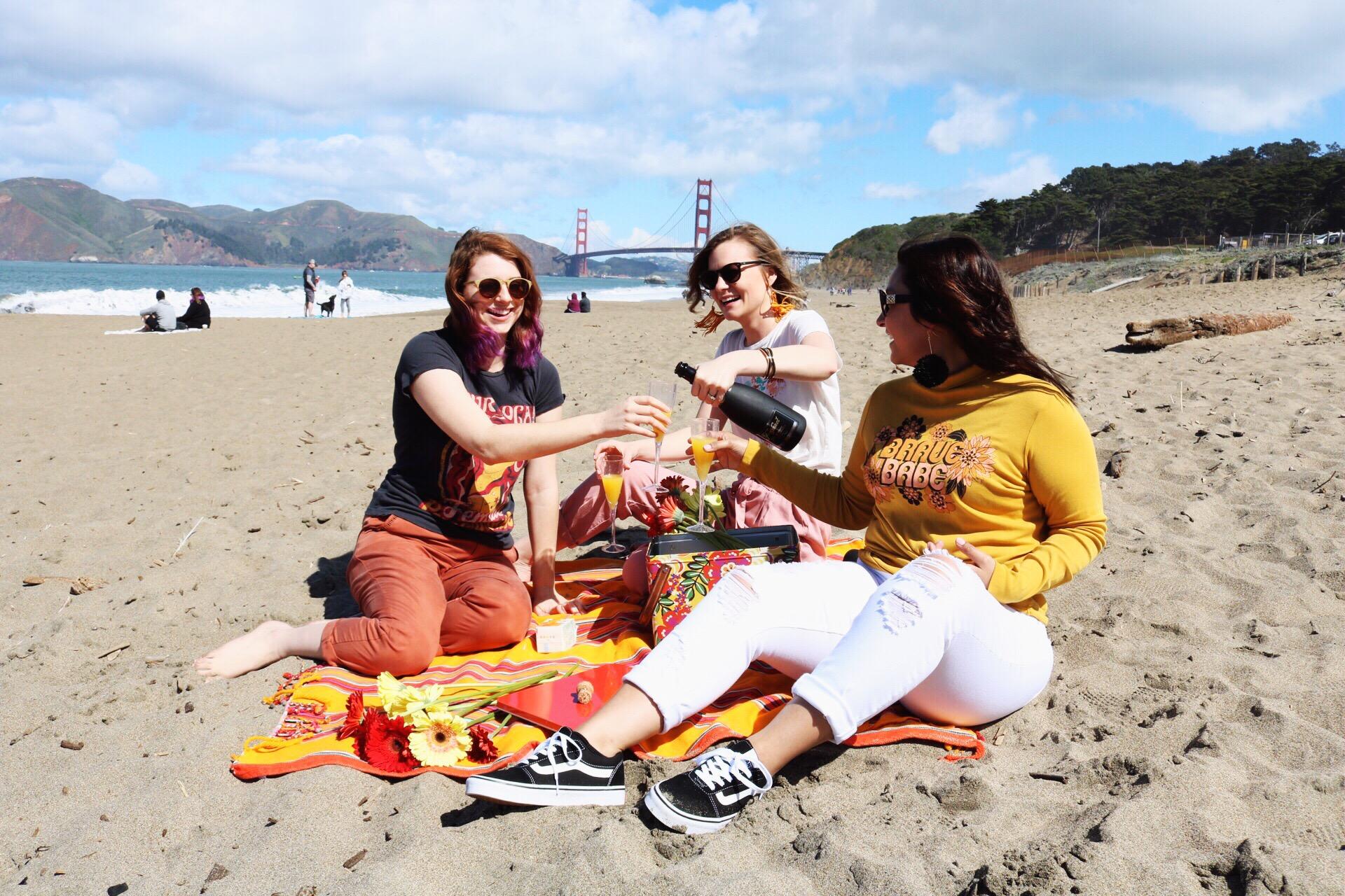 Daley_LA Feminist T-Shirts Black and White Classic Vans Distressed White Denim Orange Pants Mimosas San Fransisco Beach Picnic on the Beach Golden Gate Bridge