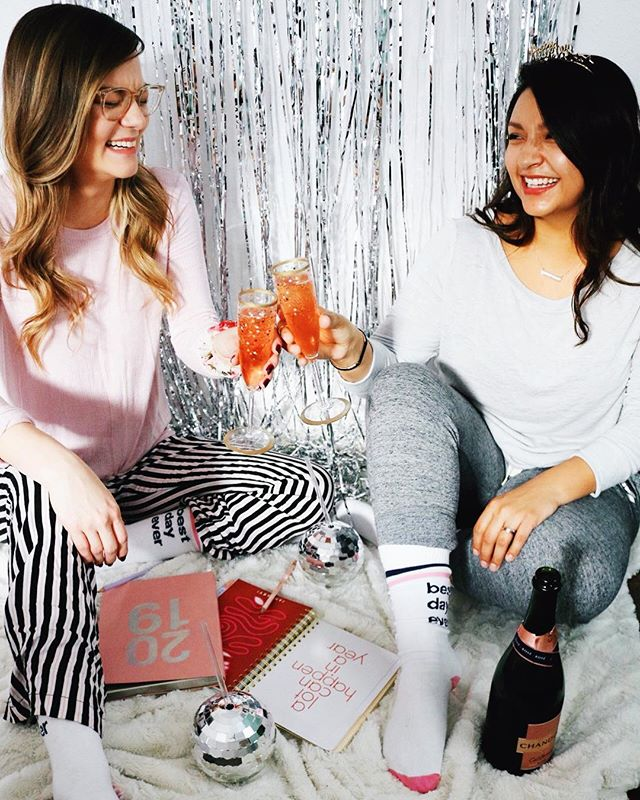 "Cheers to 2019! We hope y'all are bright eyed, bushy tailed and ready to take on an entire New Year! Or maybe you've been nursing a hang over for most part of the day and still can't believe it's 2019🤷🏽‍♀️🤷🏼‍♀️ Either way you made it and we're not judging! • As our faves over at @shopbando say ""A lot can happen in a year!"" We're looking forward to all that's ahead for our OHBI team. • We'll be taking a page from @dancinggingeralex book and will be setting #intentions for ourselves to make sure we stay on track in our personal and profesh lives. • Laughing uncontrollably while shooting content will forever be an intention because we started this blog to have fun! #champagnecheers #livinglively #2019 #livelyambassador #newyears  xoxo  S&A"