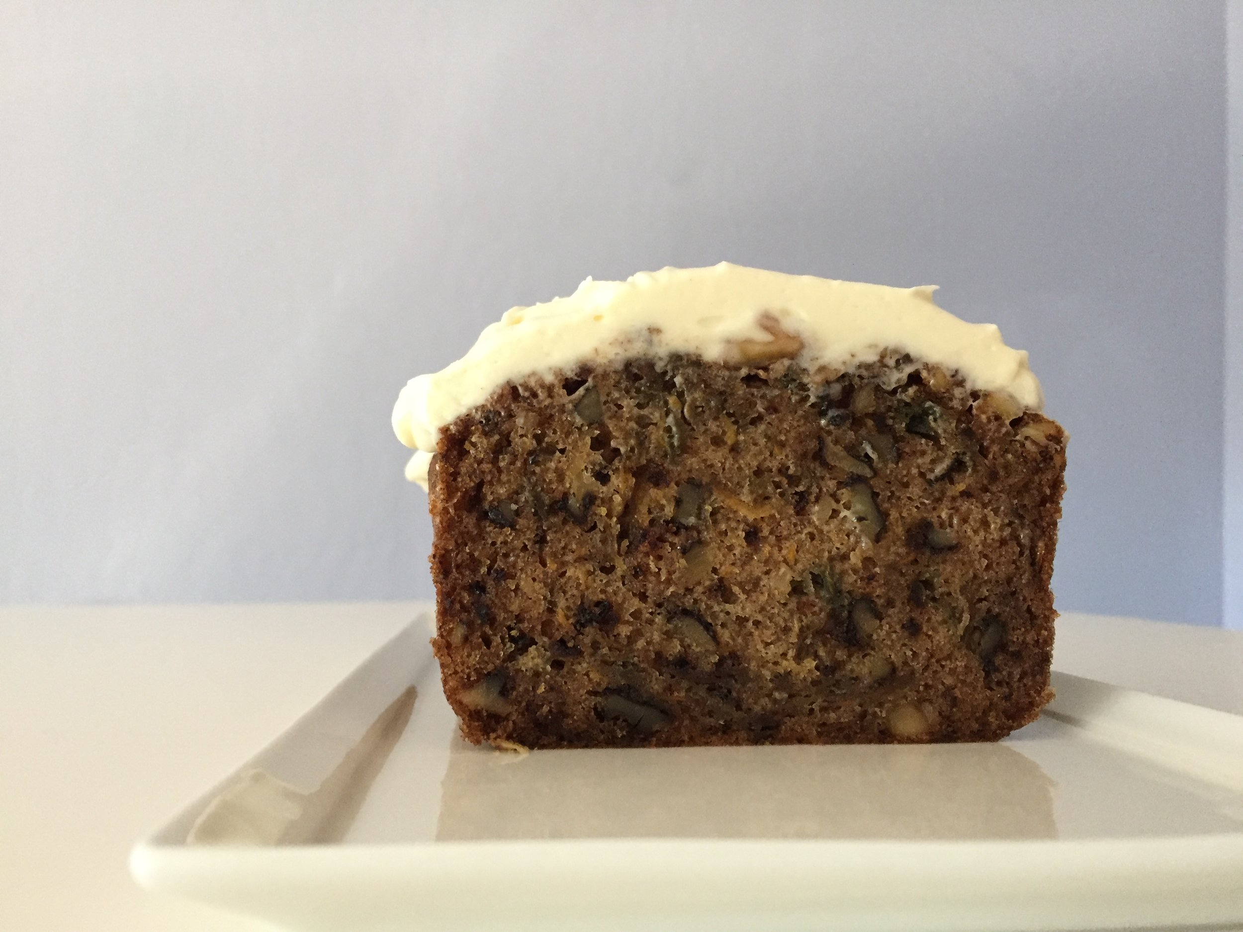 Interior of the frosted carrot cake with purple carrots