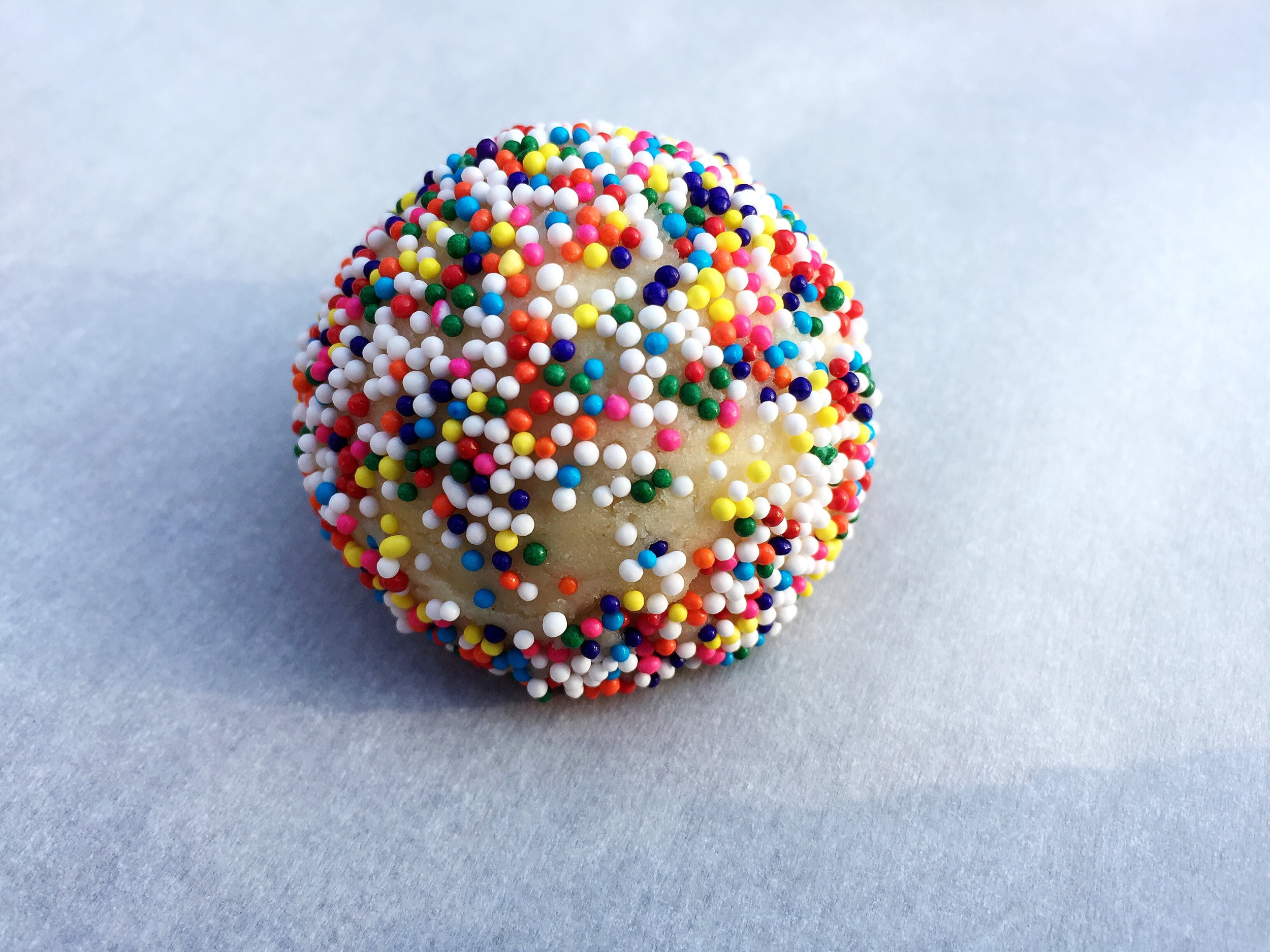 Cookie dough ball covered in nonpareils!