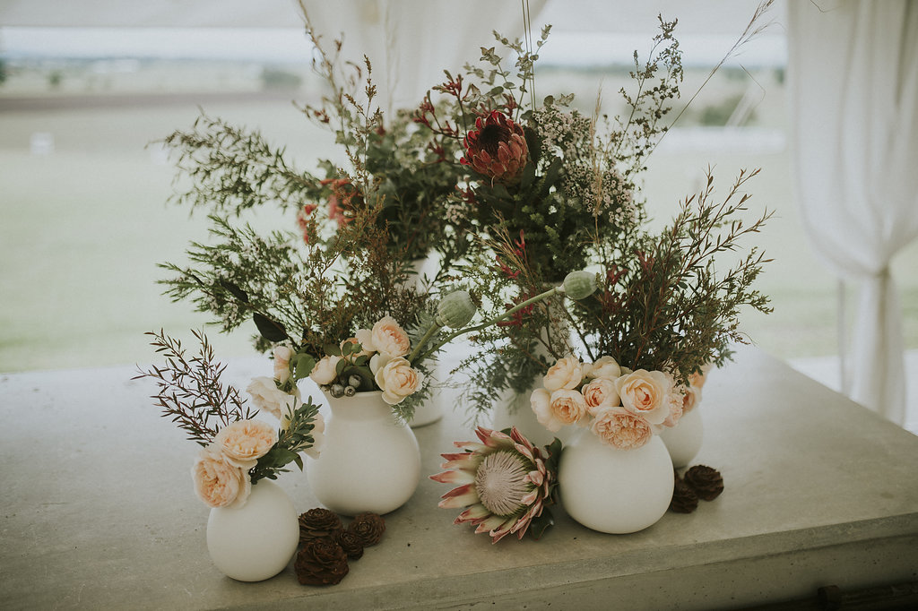 Most florists/stylists will have their own vases or can point you in the direction to hire - this saves a money/time/stress and they will be able to guide you towards what is going to work best with your florals!