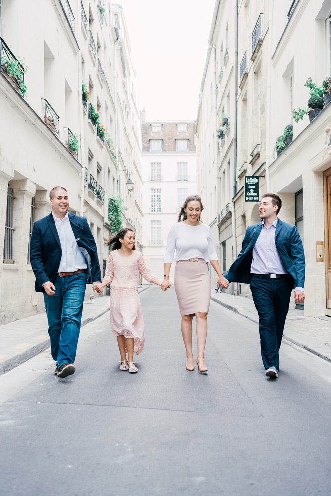 Paris family photographer - family having fun during their photo shoot in the streets of Paris