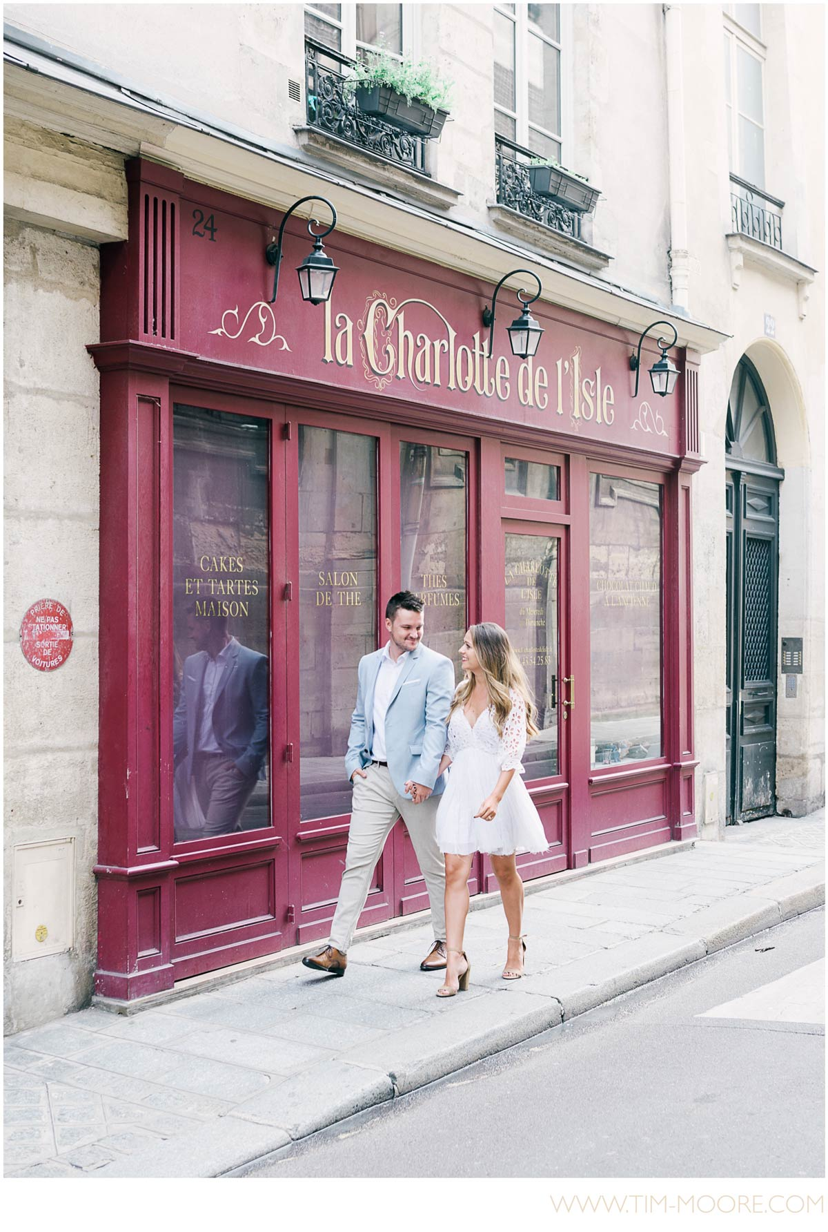 Paris Photographer - Engagement photo shoot in Paris wandering in an authentic Parisian neighborhood