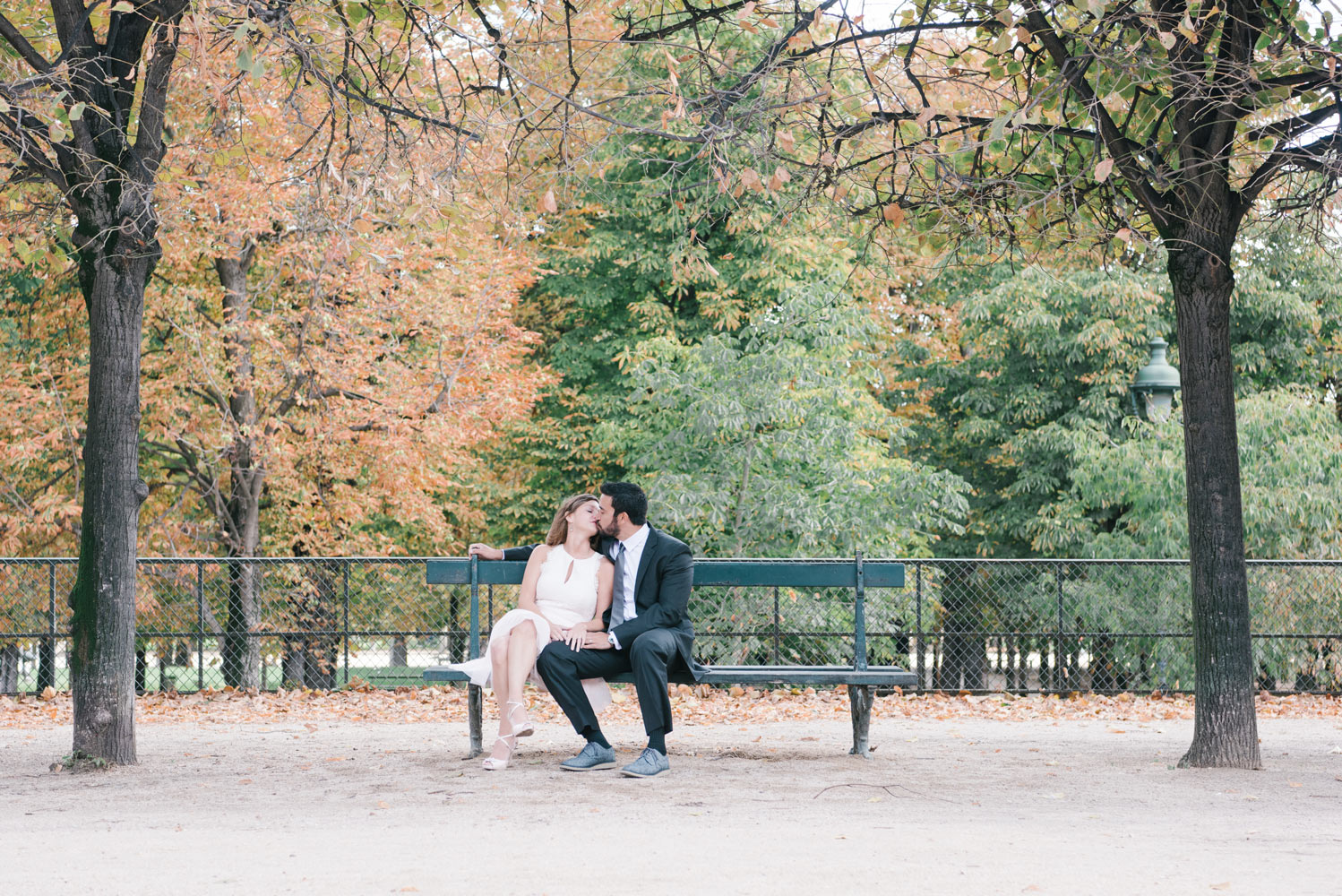 Paris Photographer Tim Moore captures the love of this couple kissing on a bench at the Tuileries Gardens in Paris.